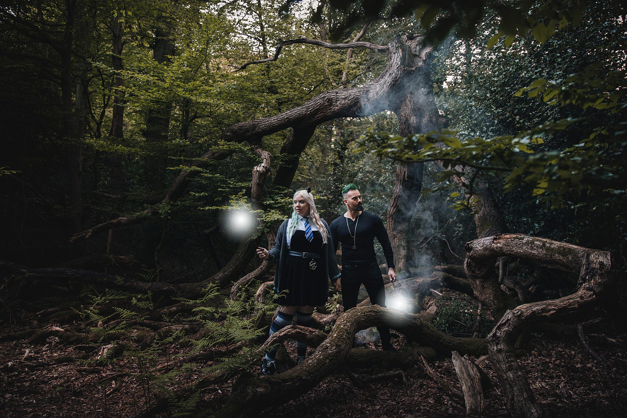 Harry Potter engagement shoot couple with wands and smoke