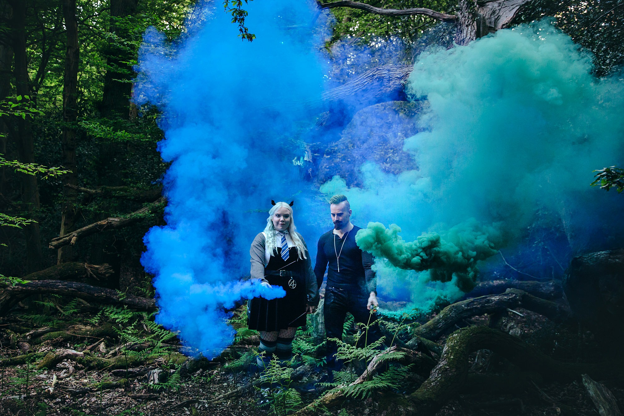 Harry Potter engagement shoot couple with green and blue smoke bombs