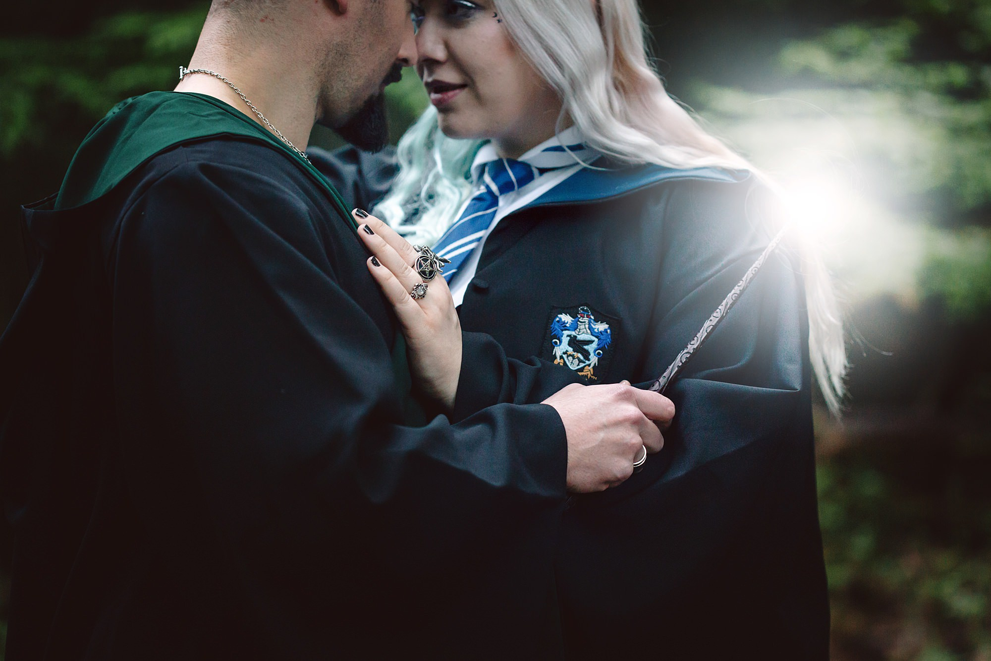 Harry Potter engagement shoot close up of couple with wands