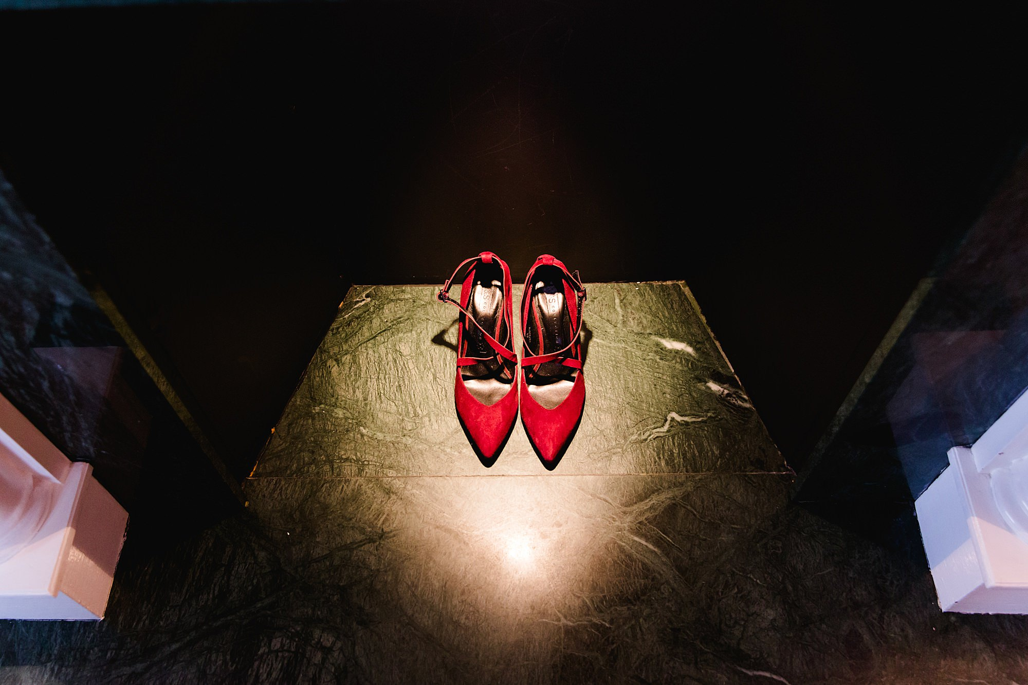 bride's red shoes in spotlight
