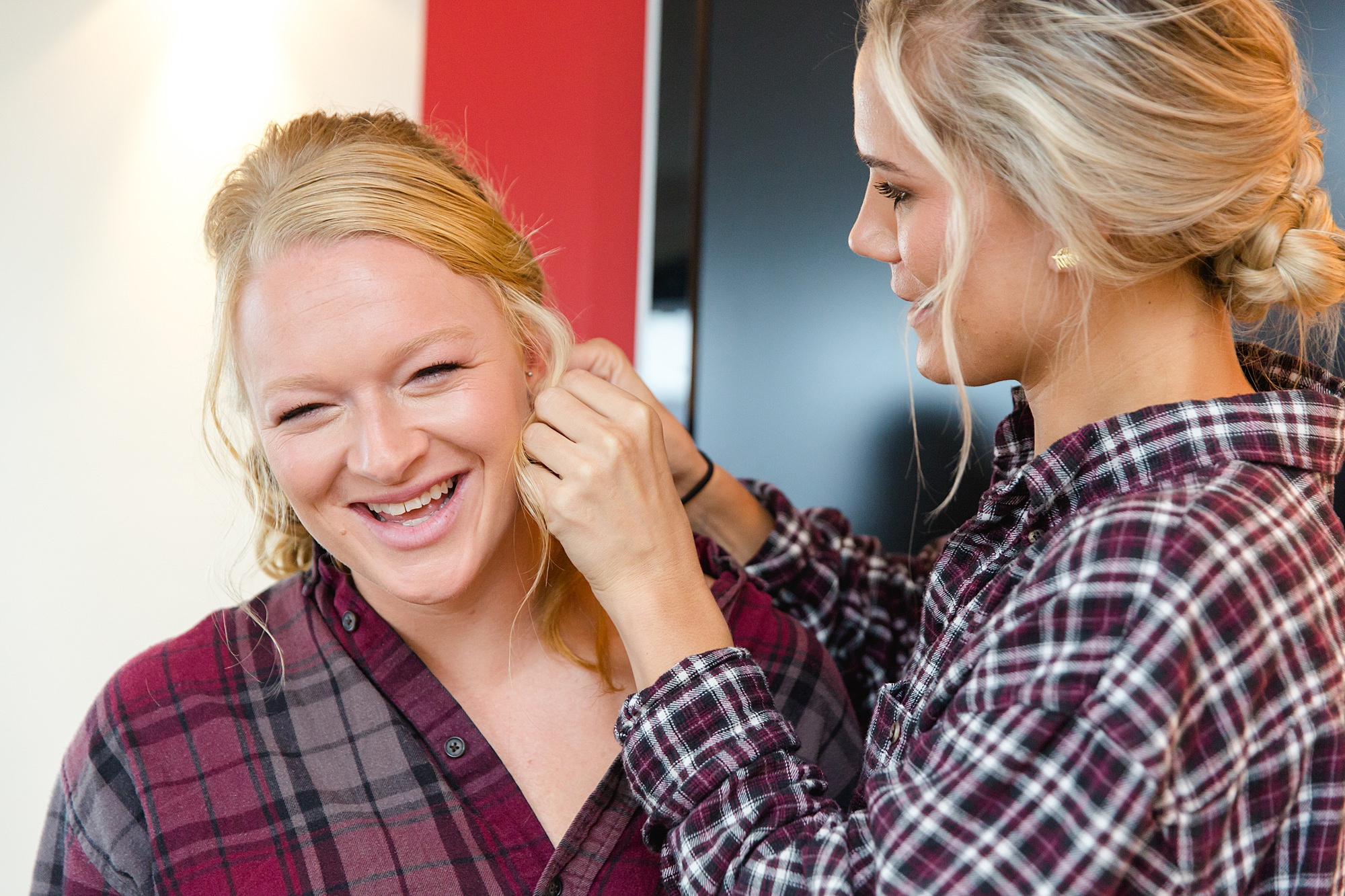 bridesmaids help each other put in earrings ahead of The Union Paddington wedding