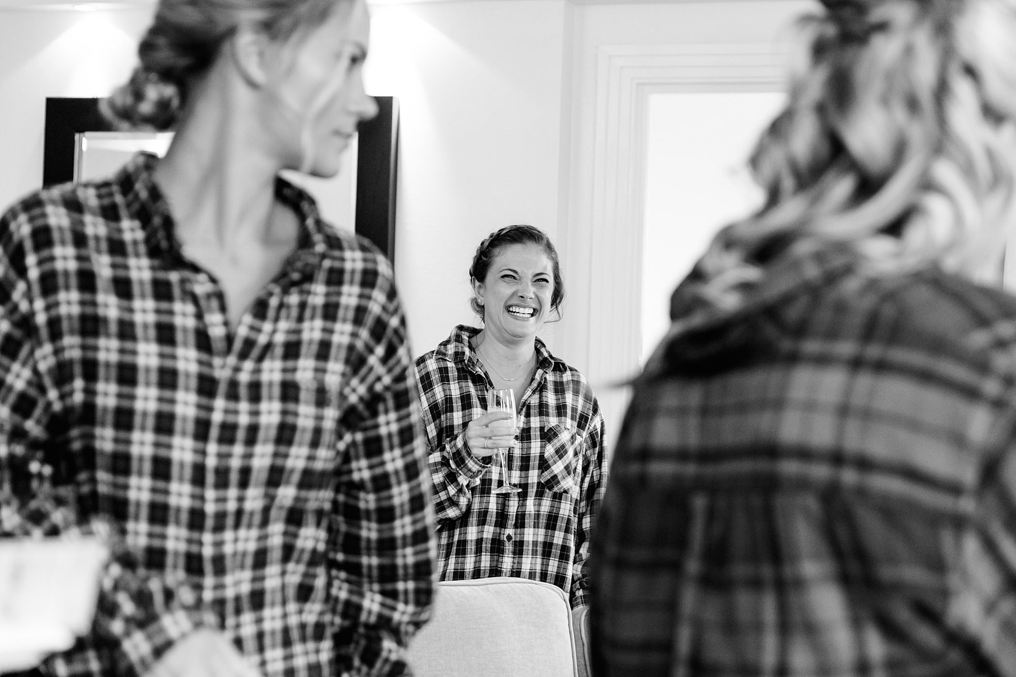 bridesmaid laughing while getting ready for wedding