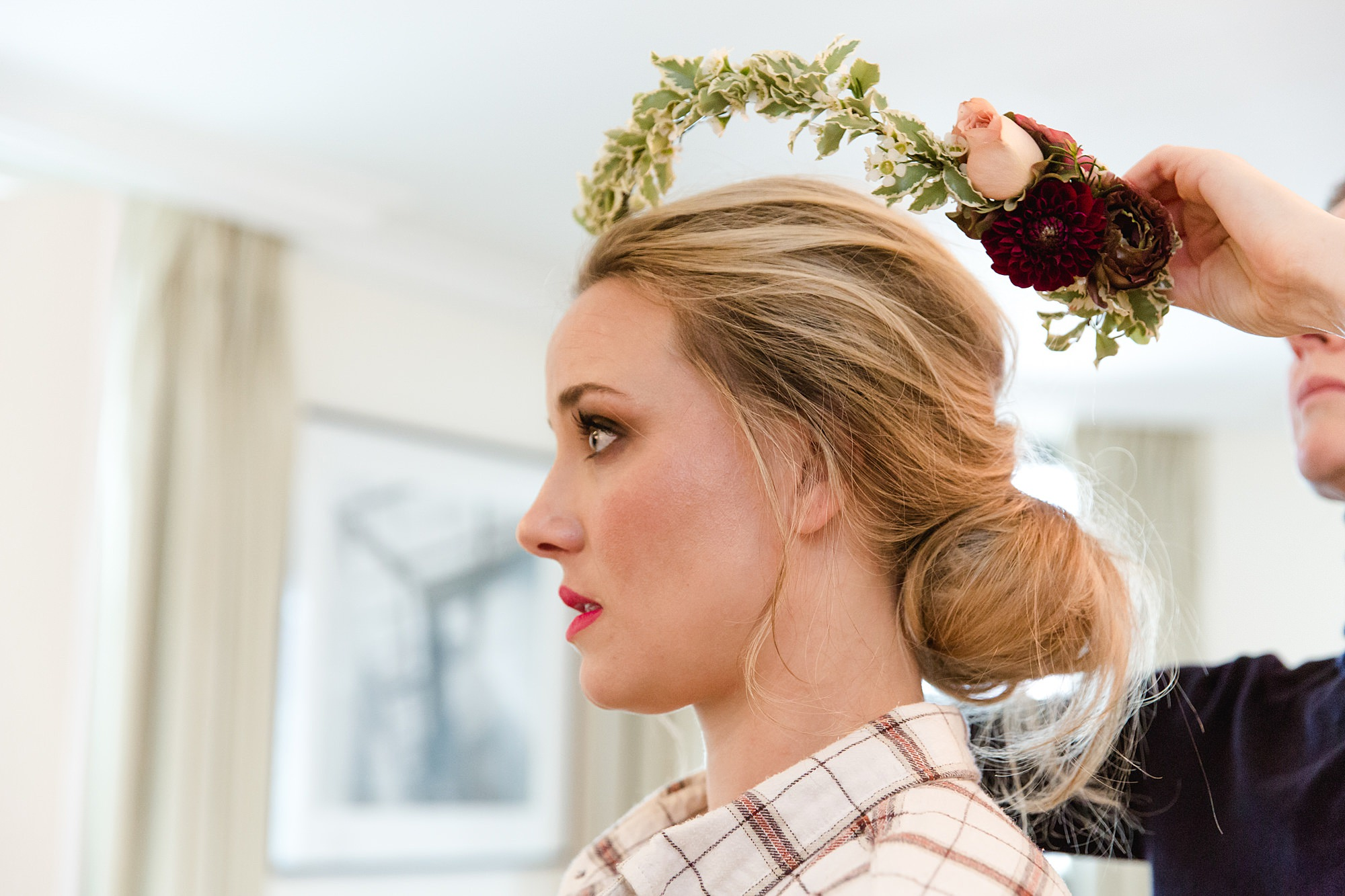 bride puts on floral crown ahead of The Union Paddington wedding