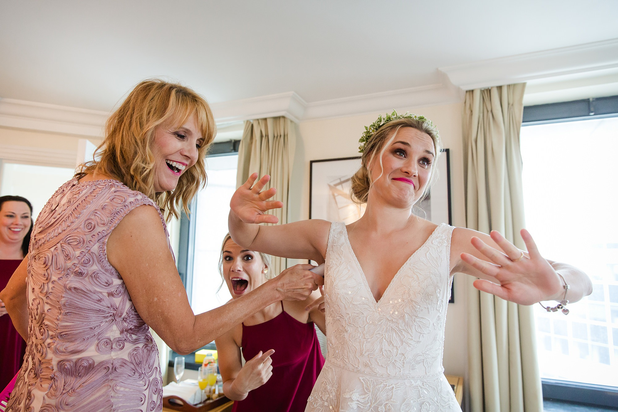 funny image of bride's mum helping her with deodorant