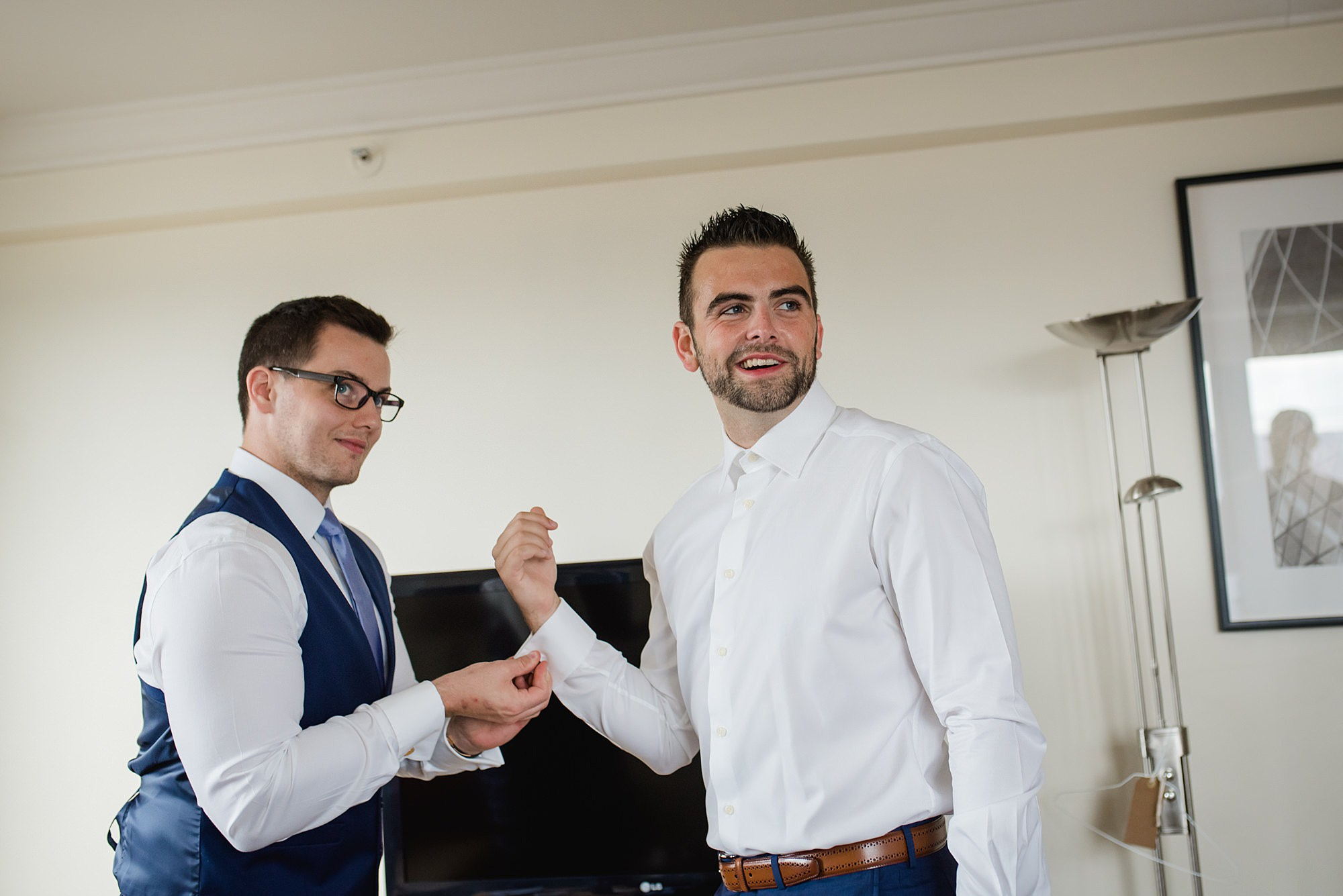 The Union Paddington Wedding groomsman helps groom with cufflinks