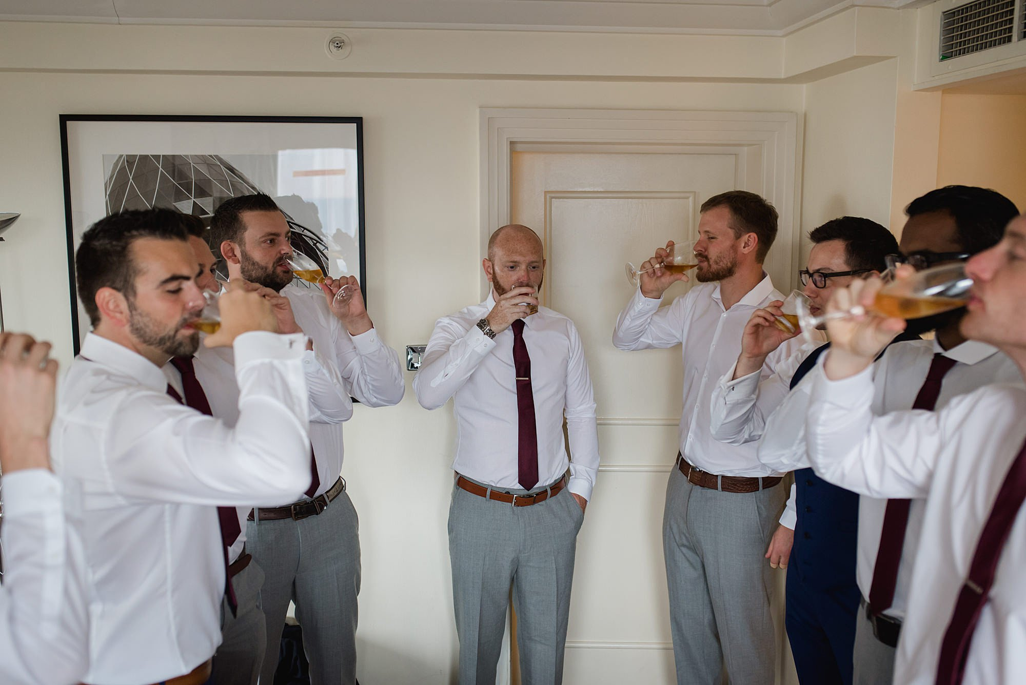 groomsmen taking a shot of whiskey together