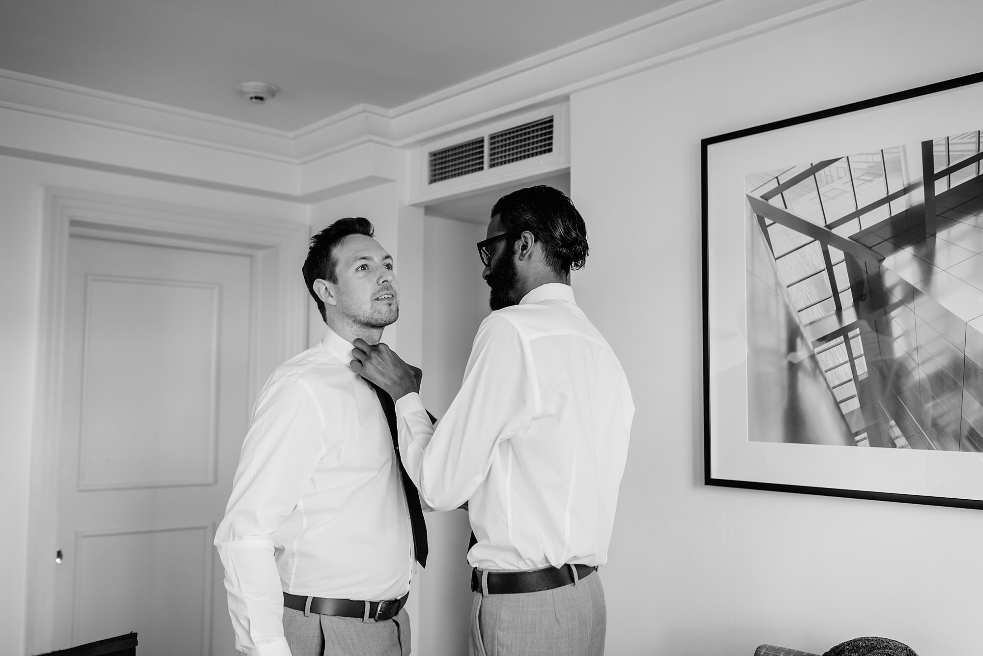 groomsmen helping each other with ties ahead of The Union Paddington Wedding