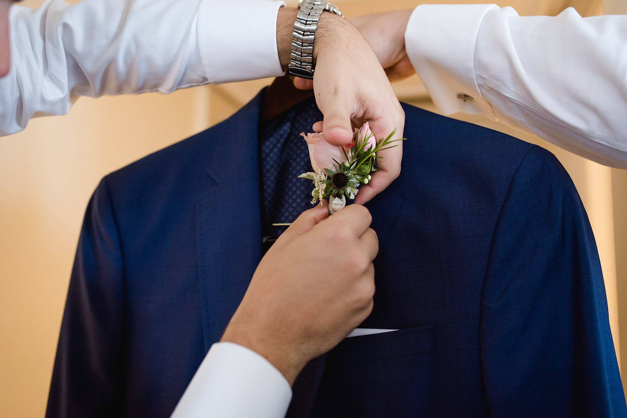 groomsmen but flower buttonhole on jacket