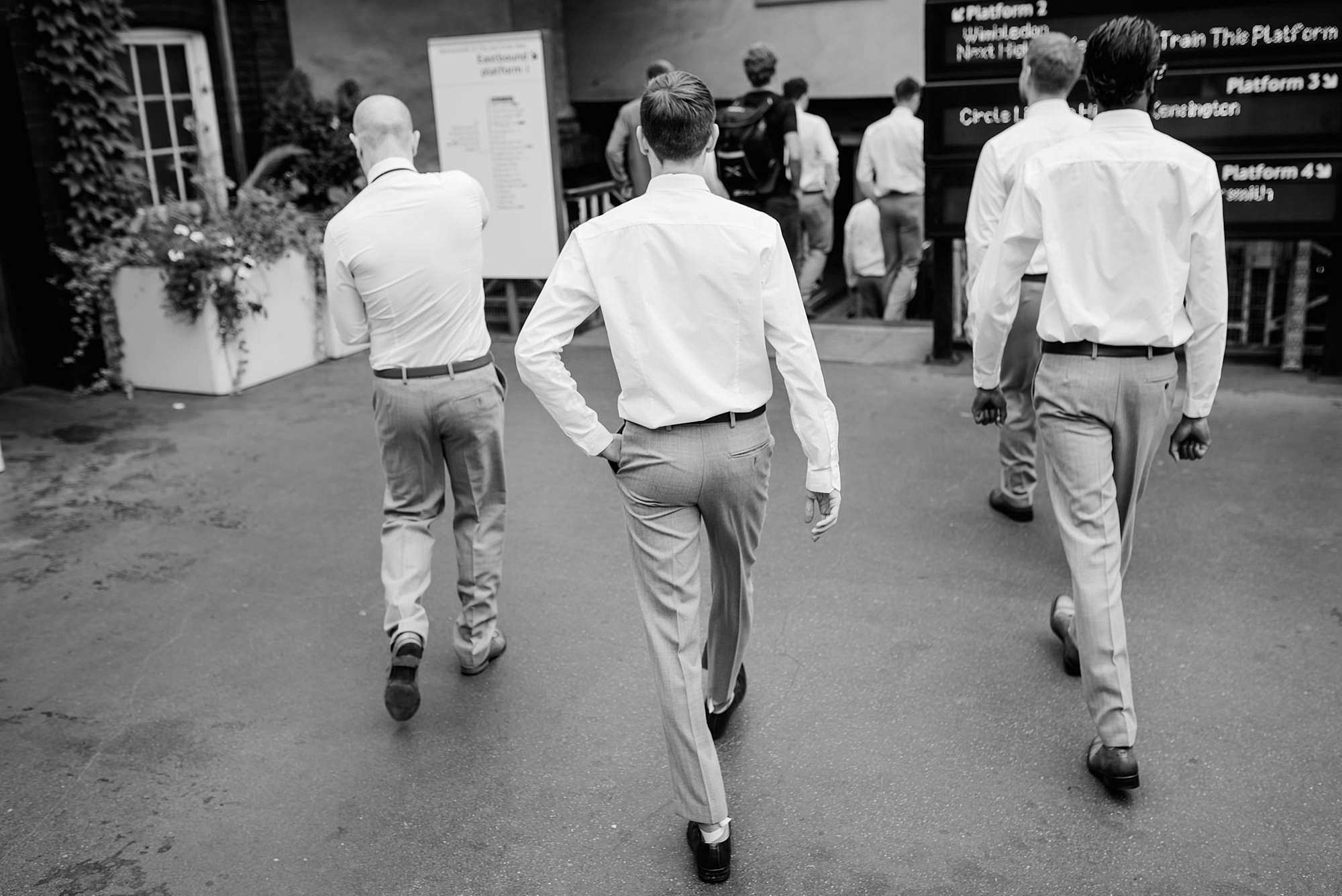 groomsmen walking to tube station together
