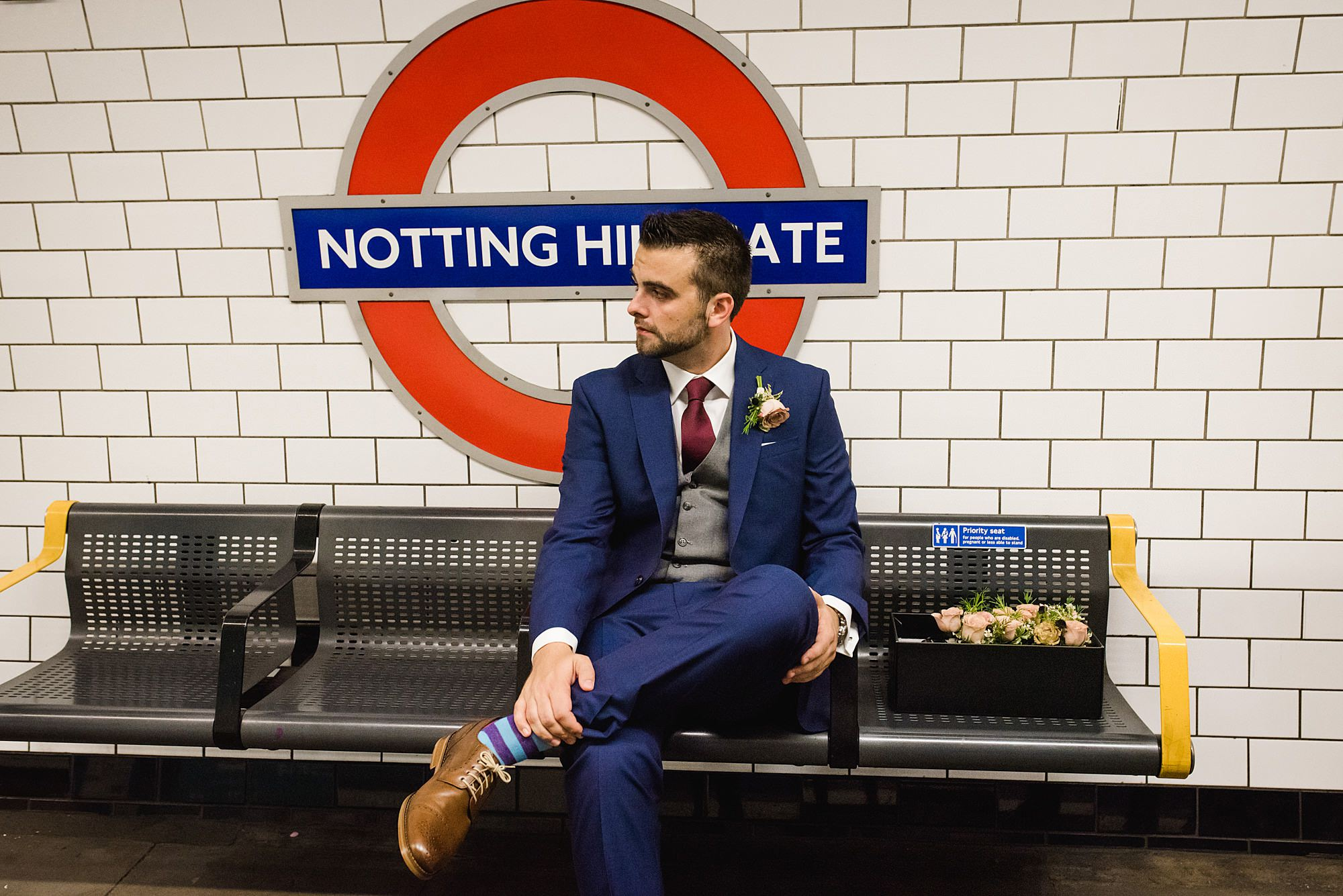 groom at notting hill gate tube sign