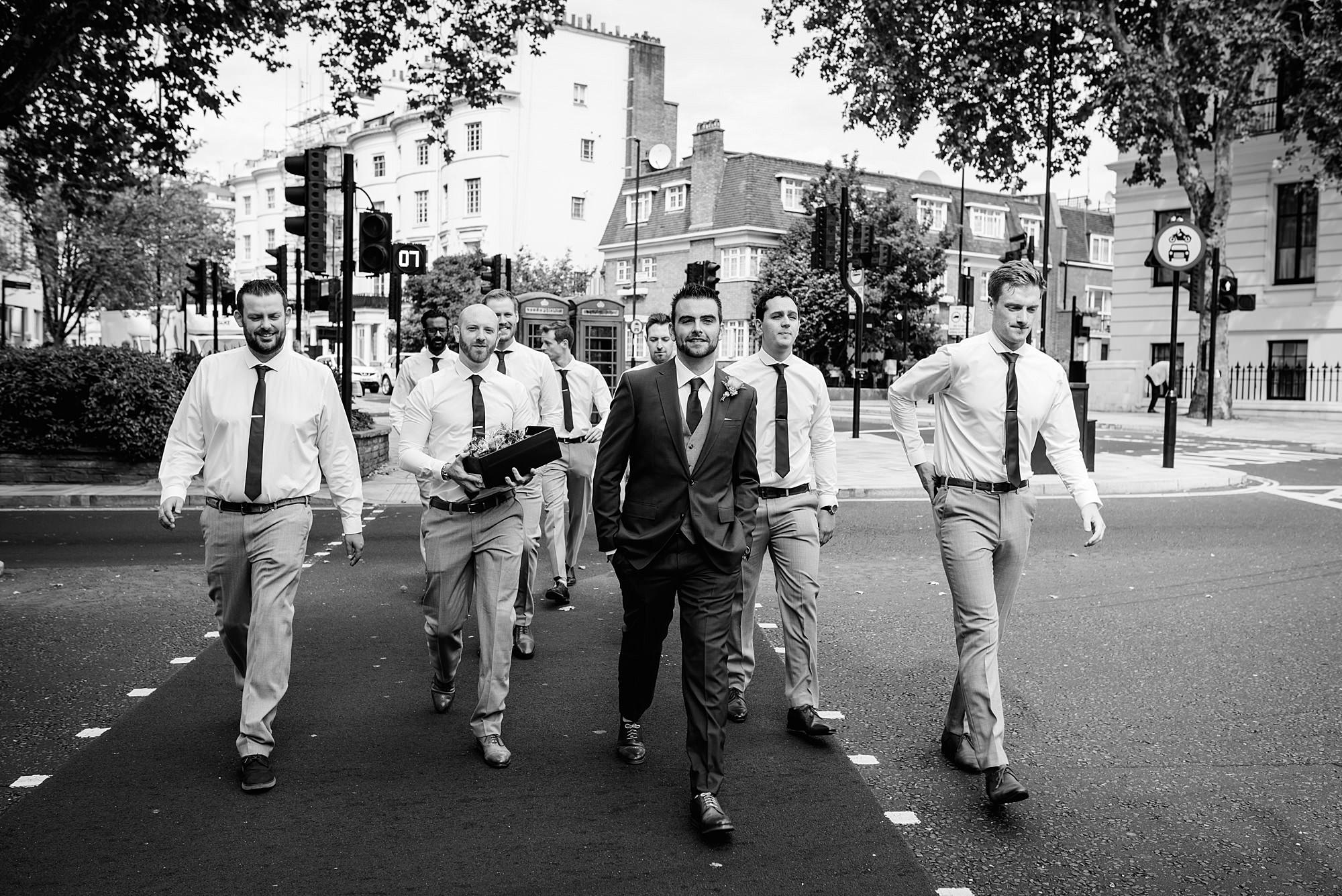 groomsmen crossing road