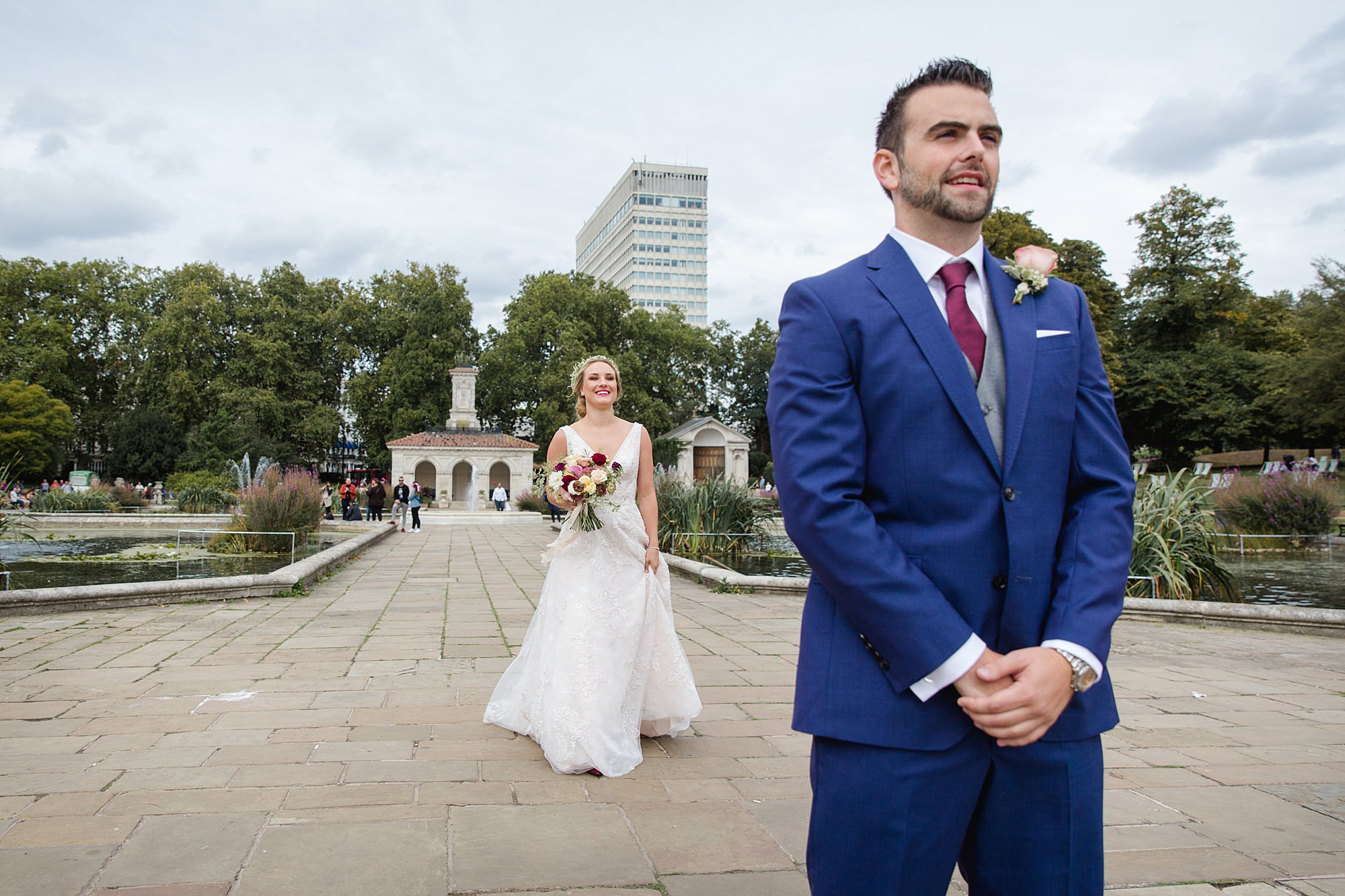 bride walks up to groom ahead of first look