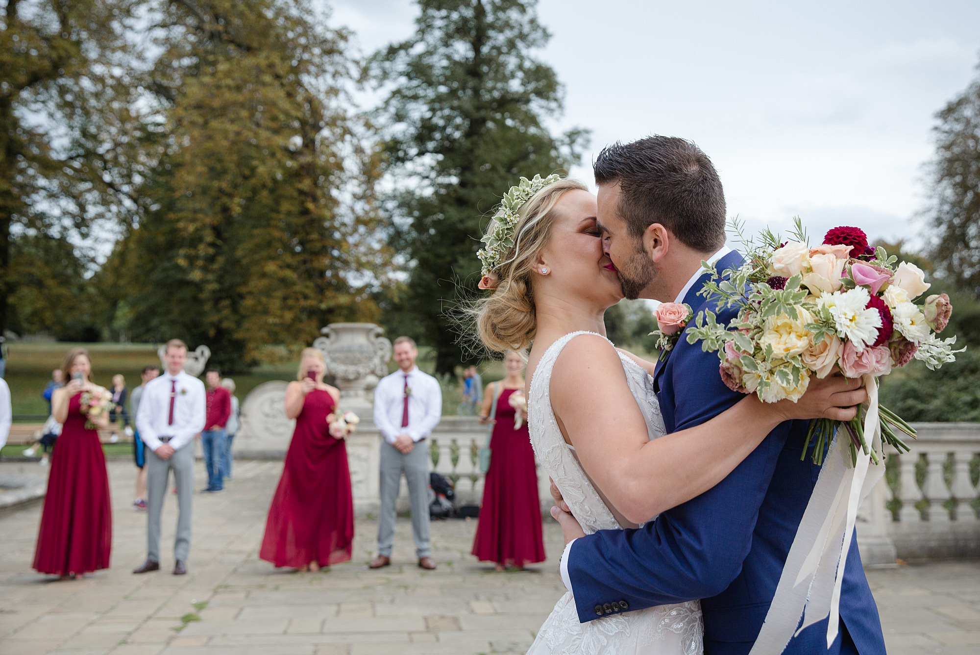 bride and groom kiss in kensington gardens