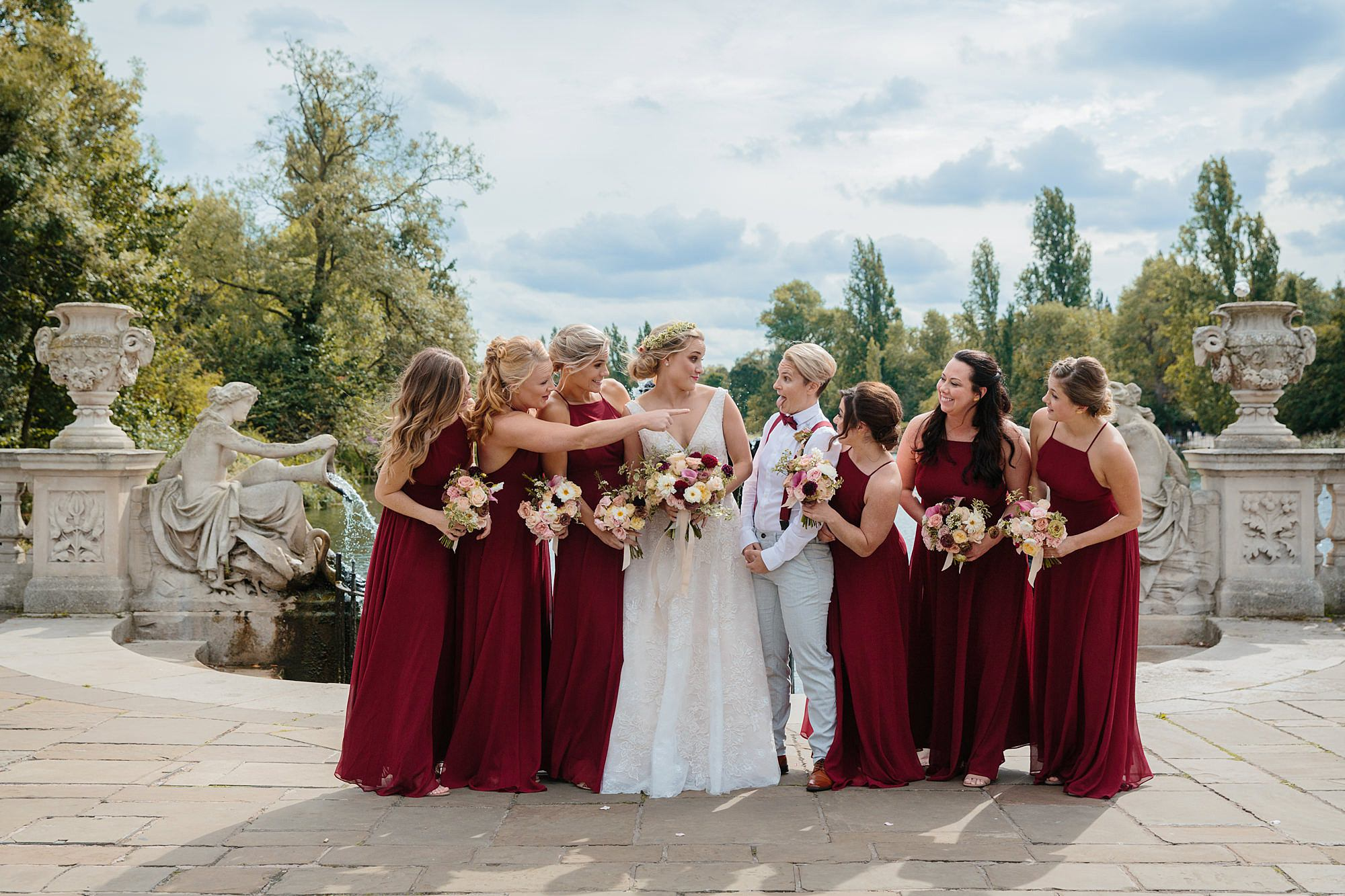 bride and bridesmaids laugh together at italian gardens