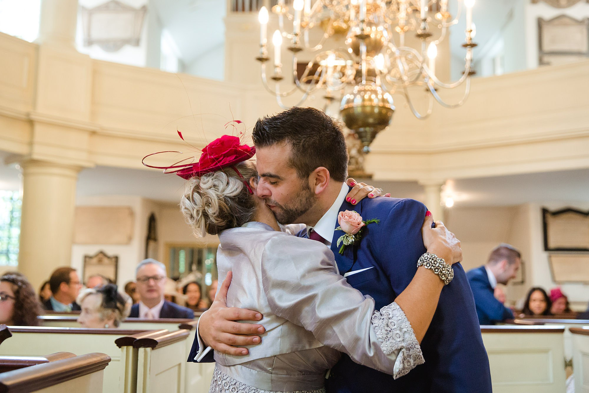 groom hugs his mum ahead of wedding ceremony