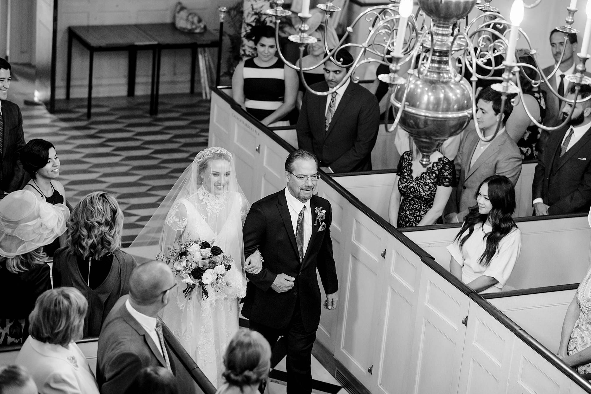 bride and her father walk down the aisle at paddington wedding