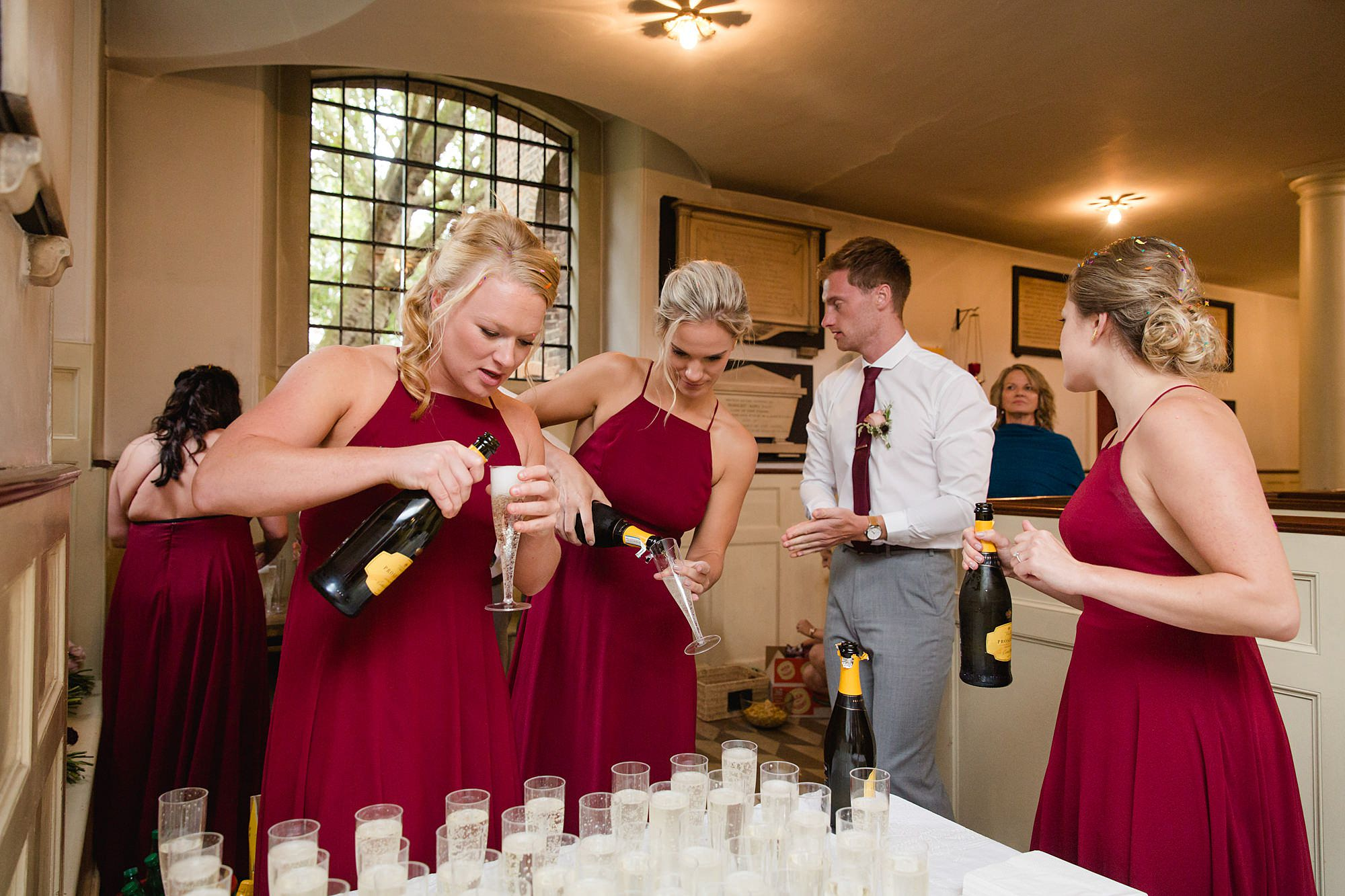 The Union Paddington wedding bridesmaids pour champagne for drinks