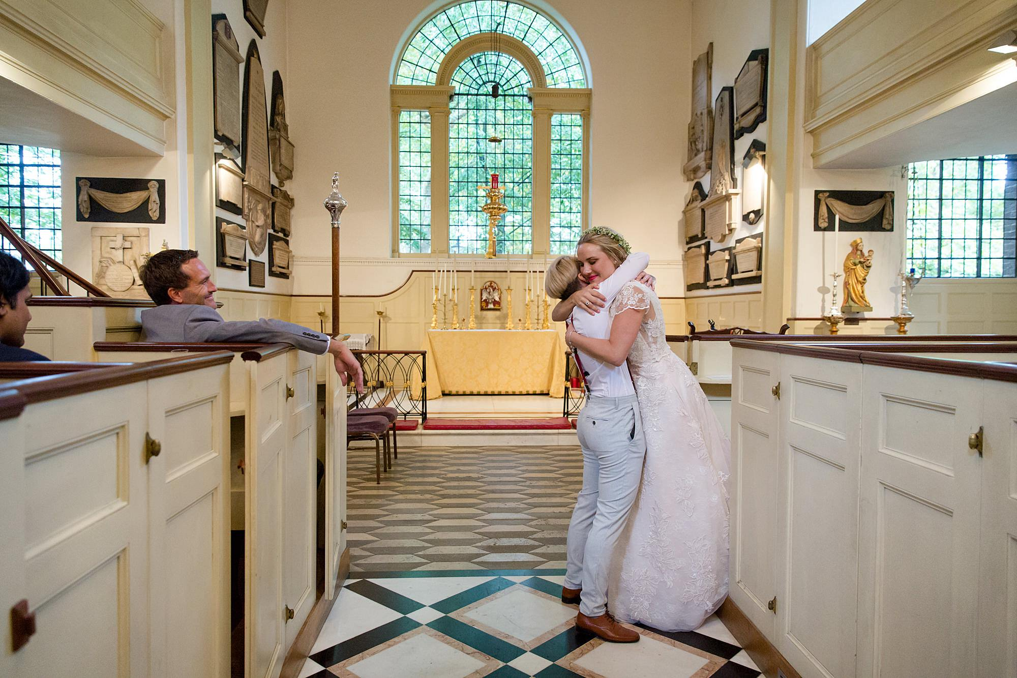 bride hugs bridesmaid during paddington church wedding