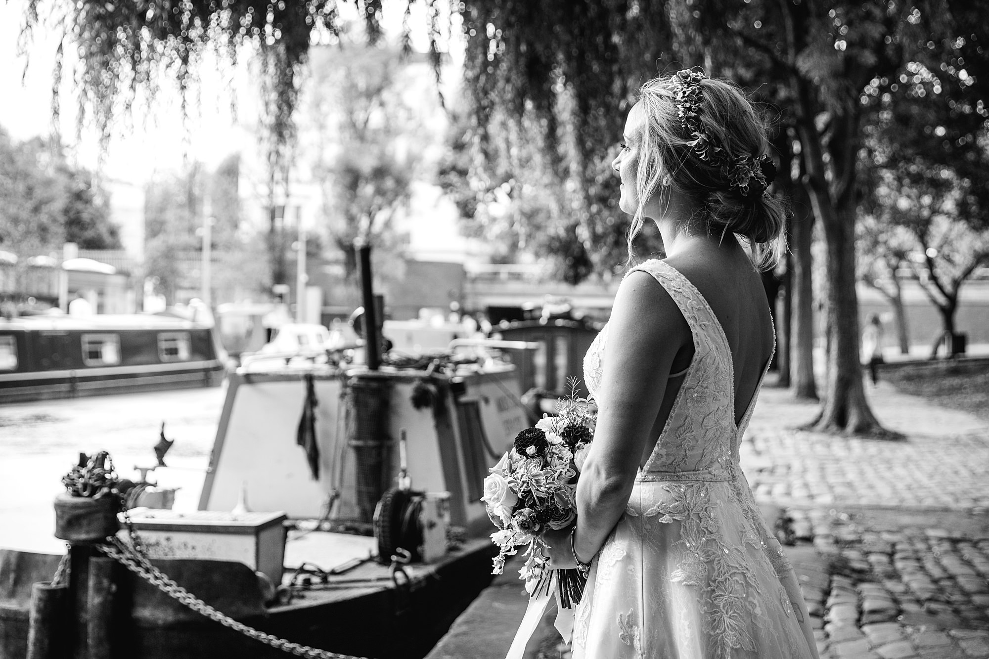 bride looking out over canal boats in paddington