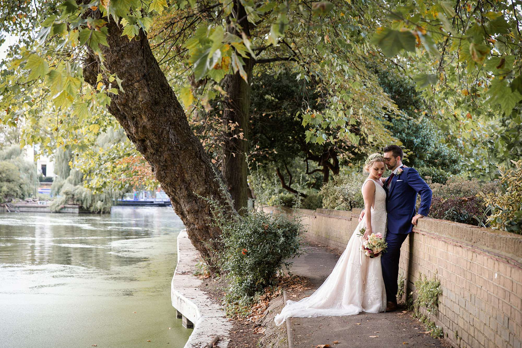 bride and groom in path on canal banks in paddington