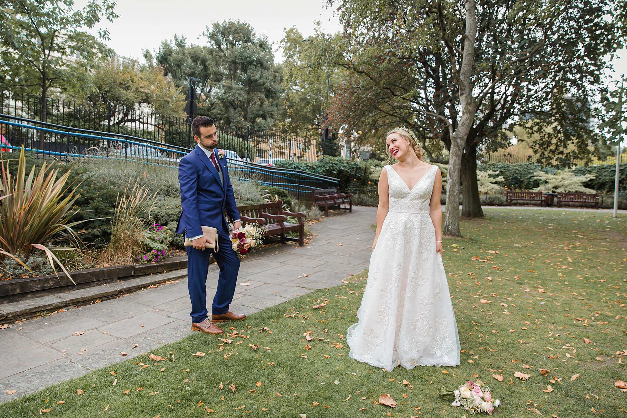 fun portrait of bride and groom in paddington gardens