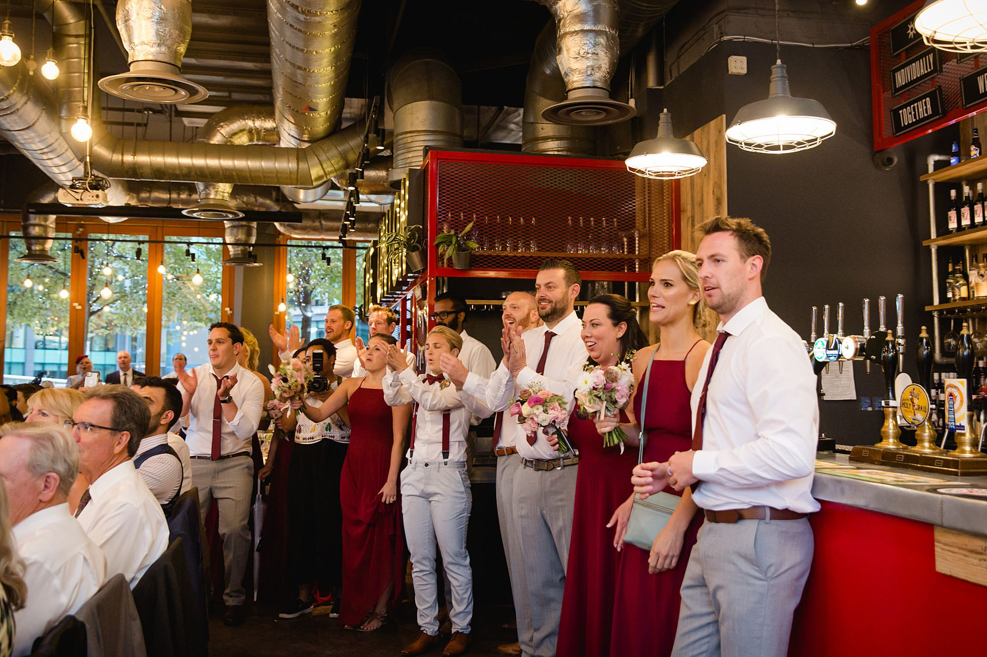 The Union Paddington wedding party cheer for bride and groom