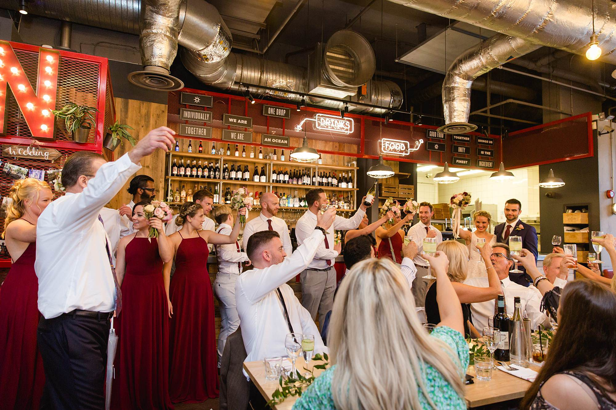 The Union Paddington wedding party toast to bride and groom