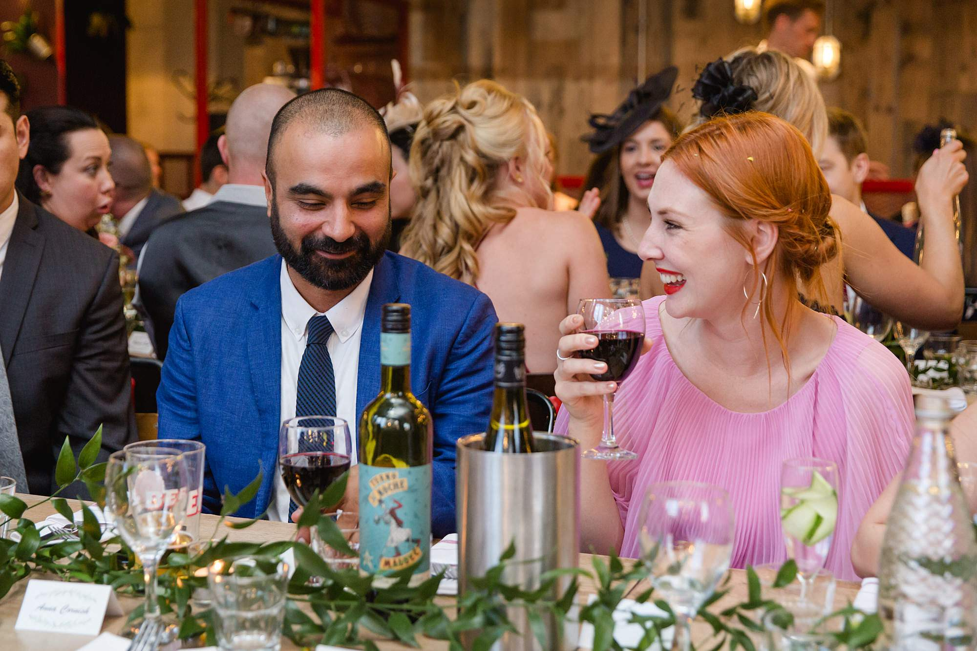 The Union Paddington wedding guests laugh together over dinner
