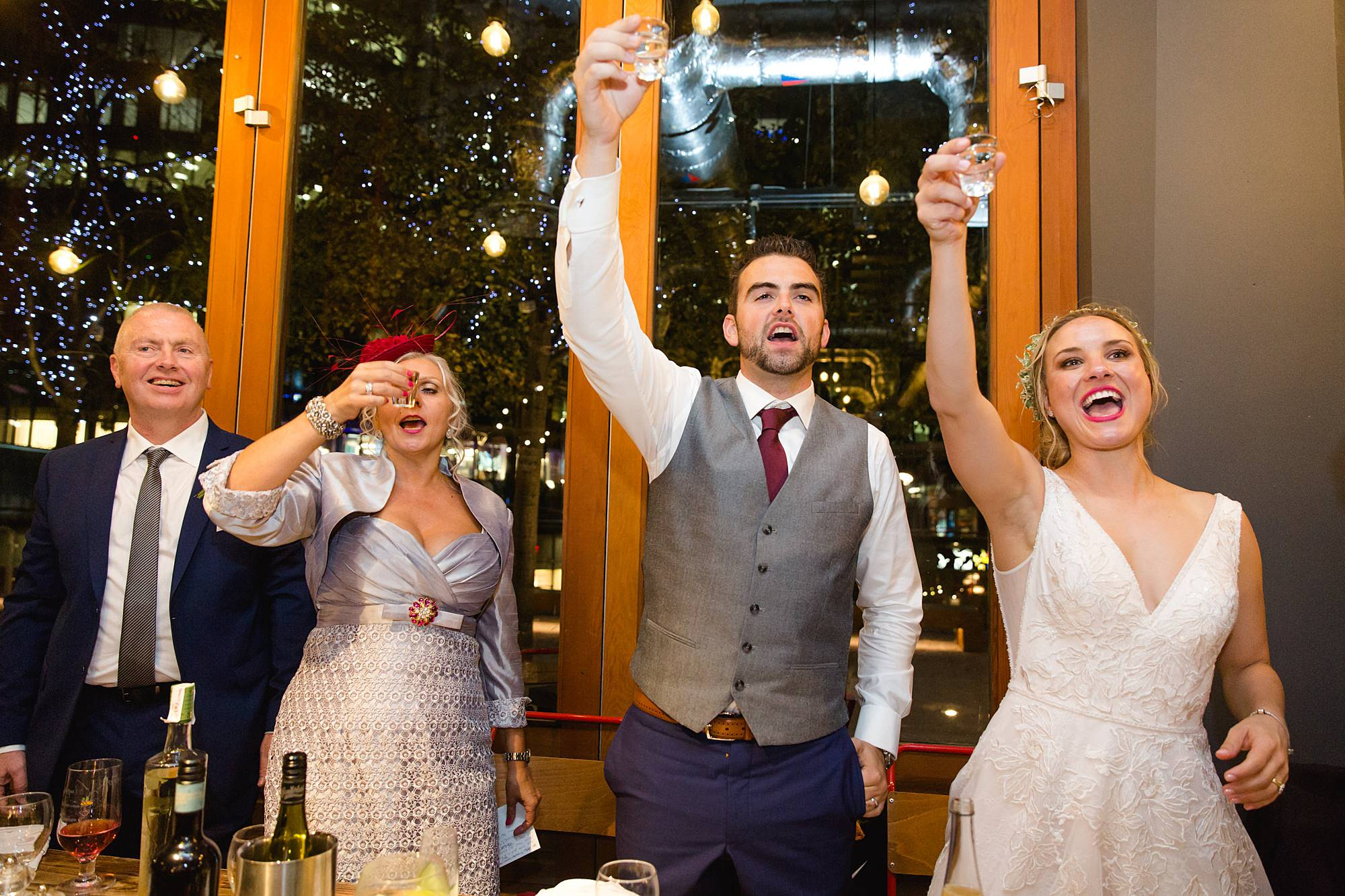 bride, groom and groom's mother toast speeches with a shot