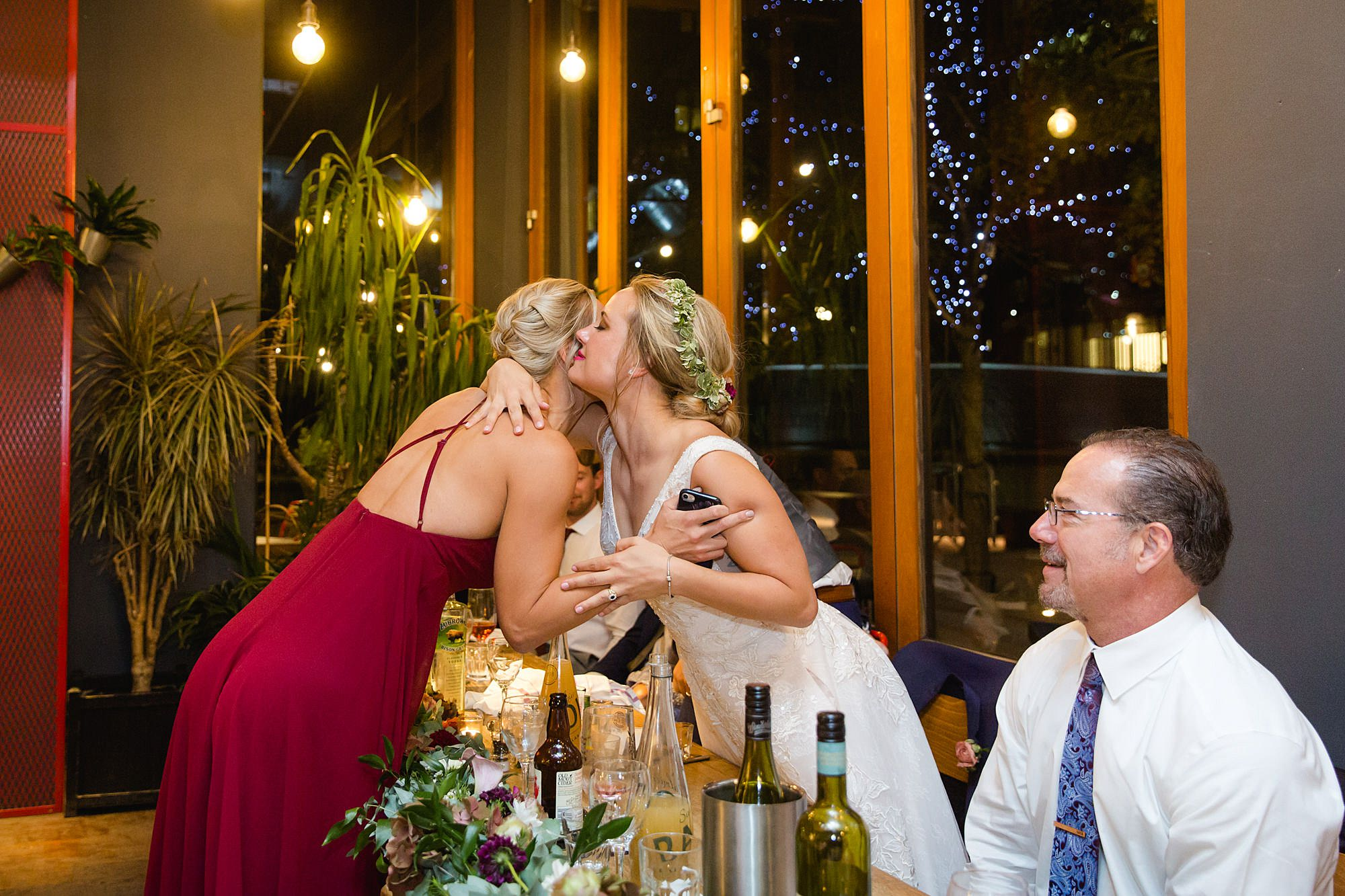 bride hugs bridesmaid after speech at the union pub wedding