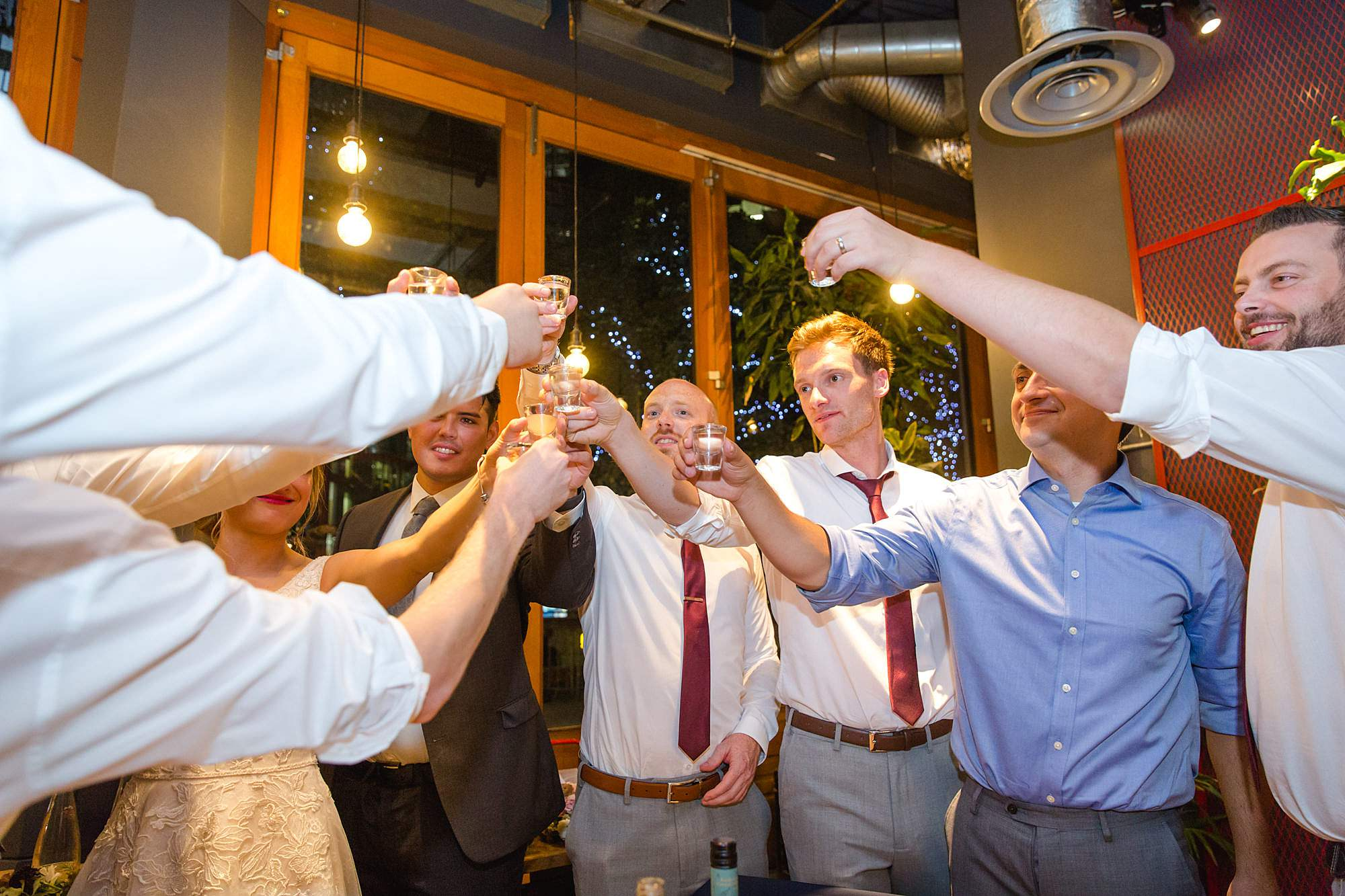 The Union Paddington wedding guests toast with shots