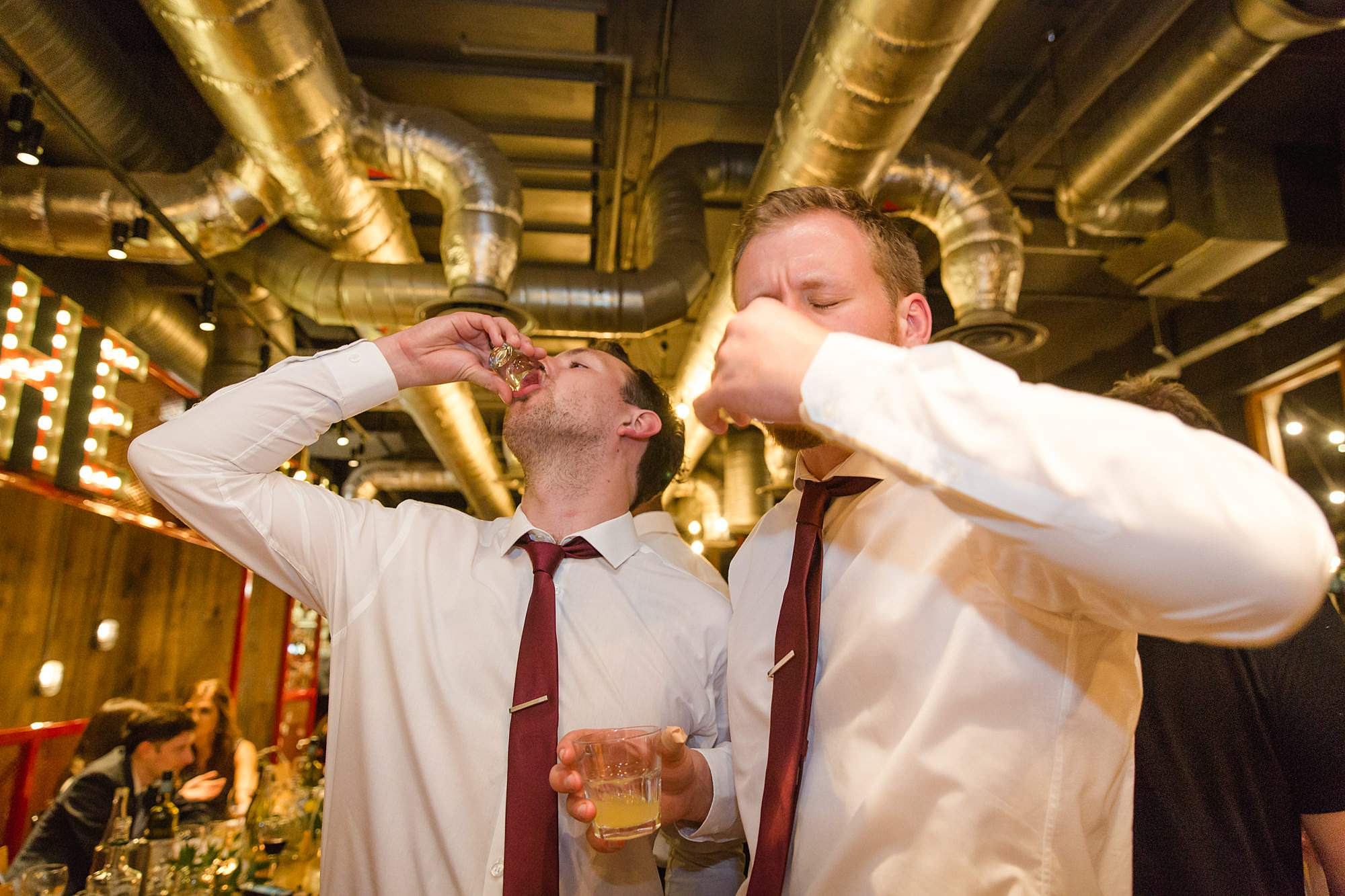 groomsmen doing shots at the union pub