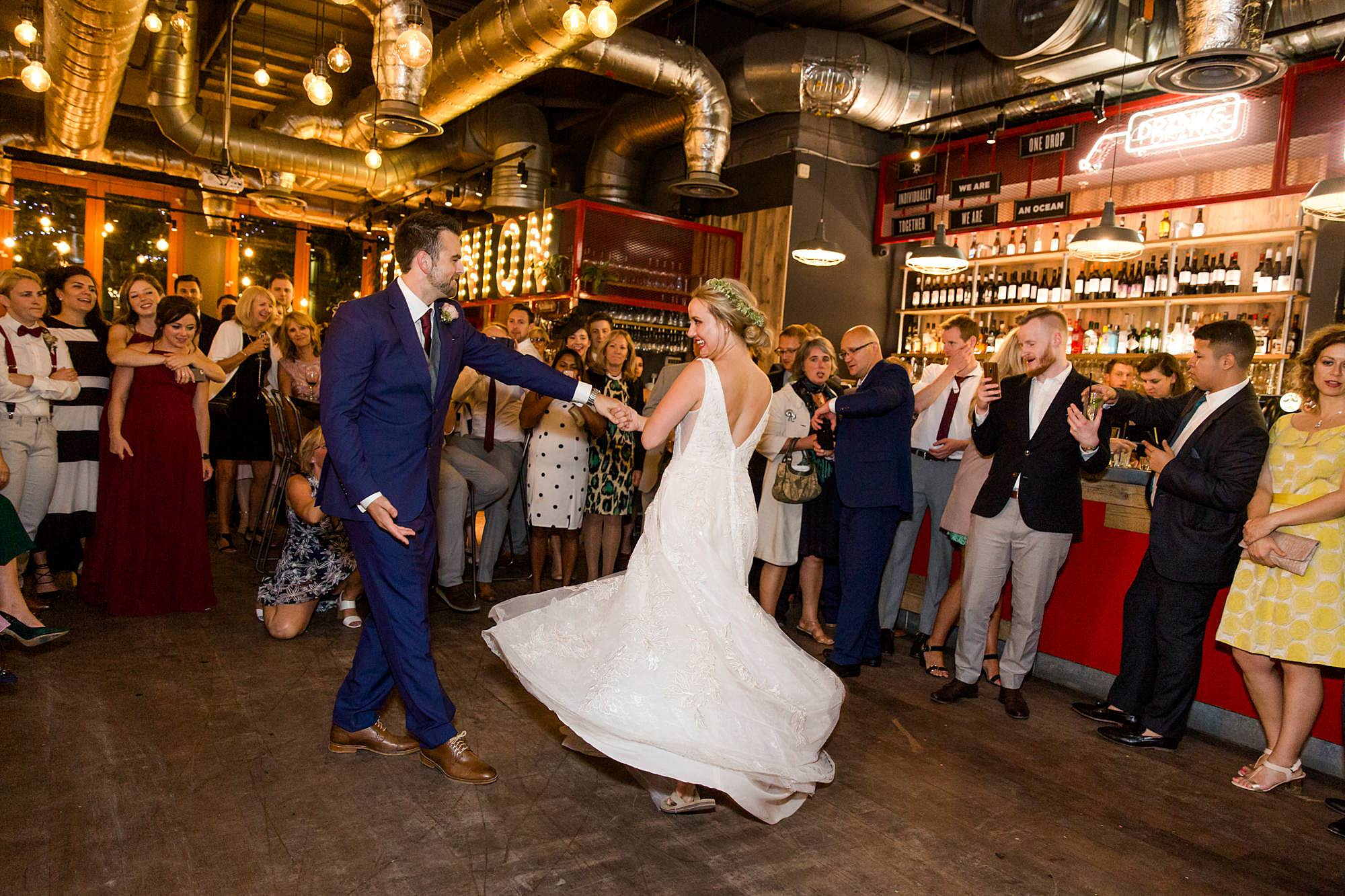 The Union Paddington wedding groom twirls bride for first dance