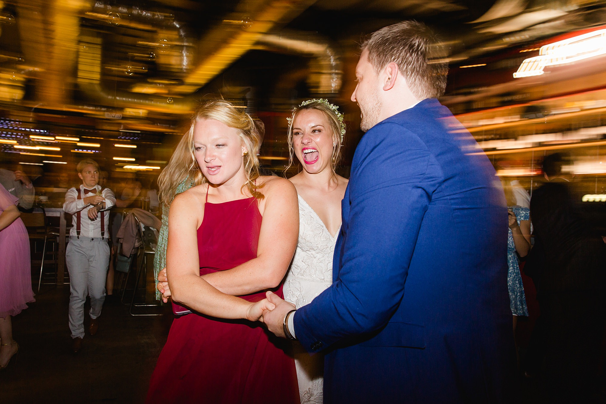 bride laughs at dancing guests at the union pub wedding