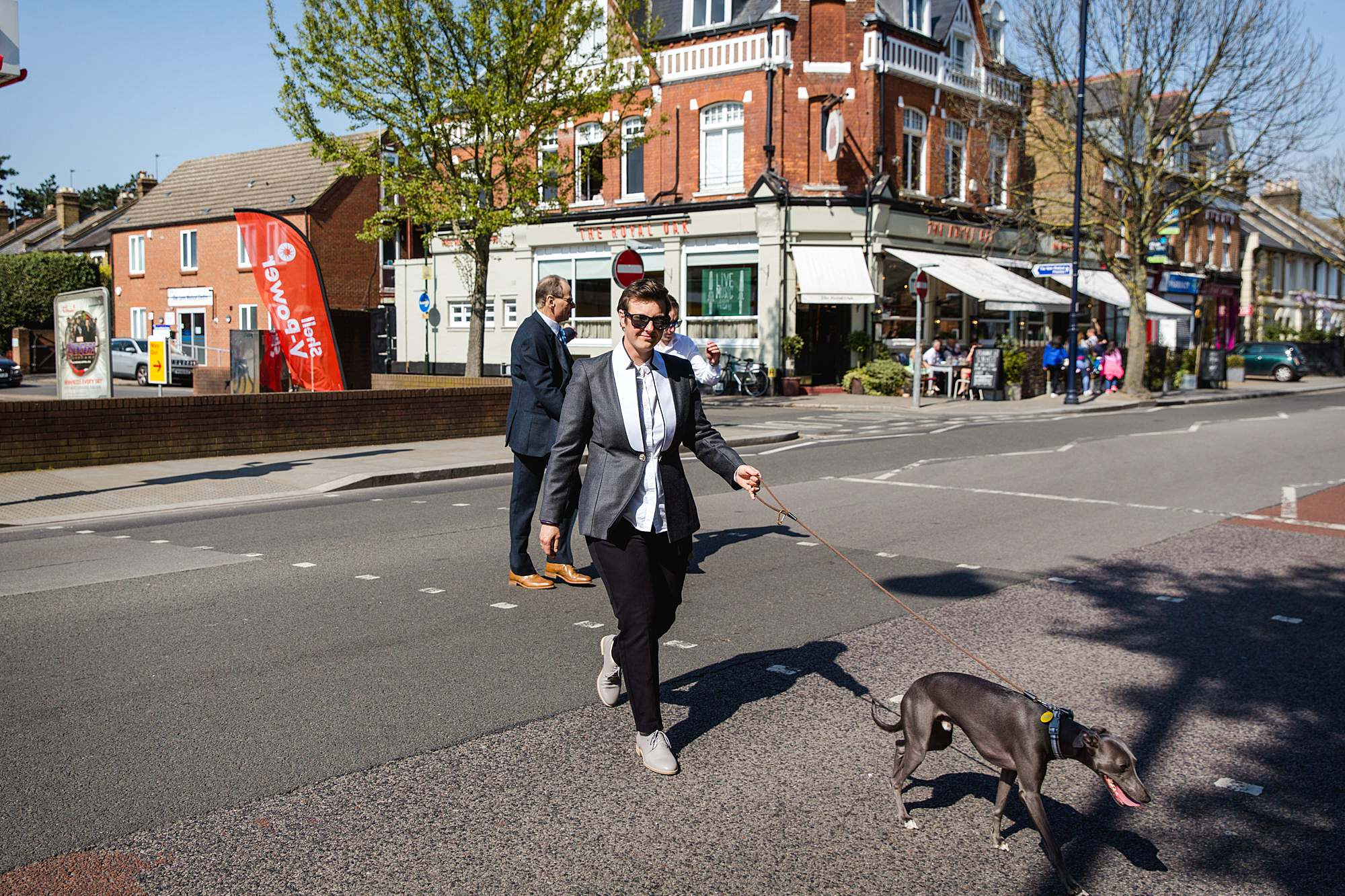 bride walks her dog to wedding ceremony in twickenham