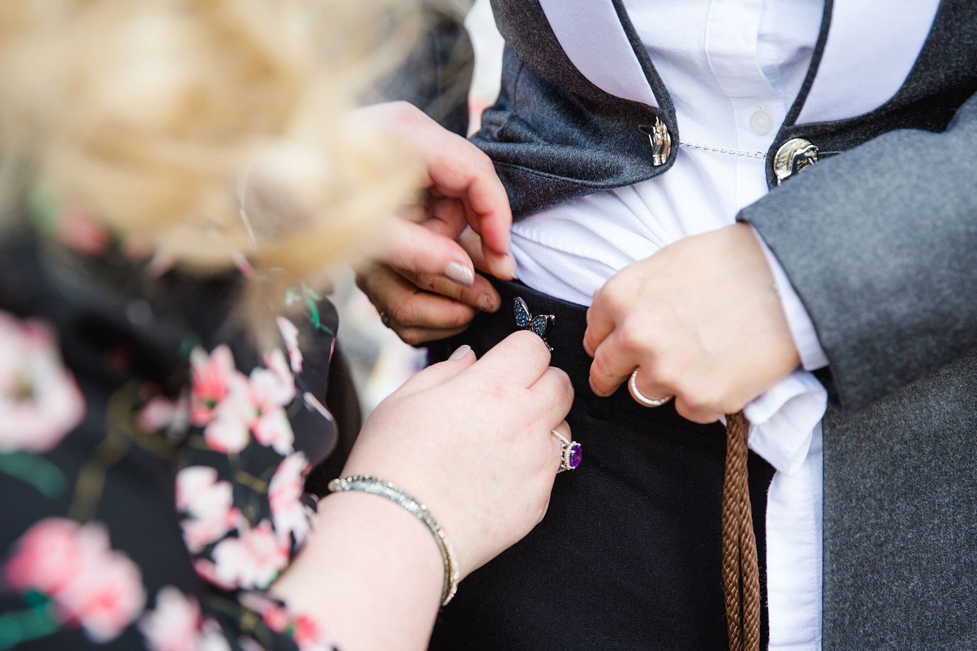 bride puts on lucky blue brooch ahead of wedding ceremony in twickenham