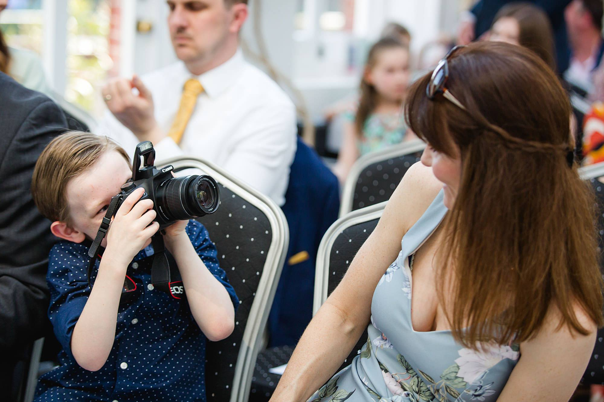 wedding guest takes a photo ahead of ceremony at york house