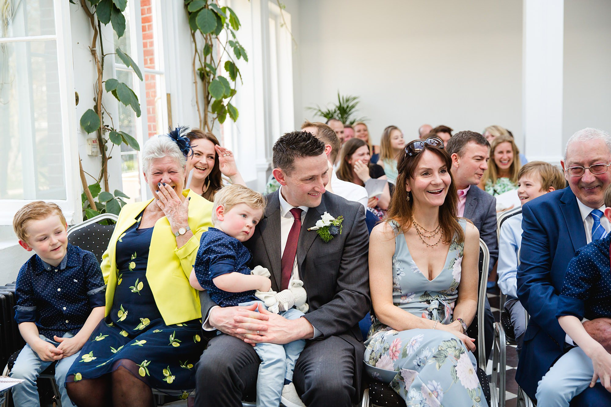 Twickenham wedding photography guests laughing during york house wedding ceremony