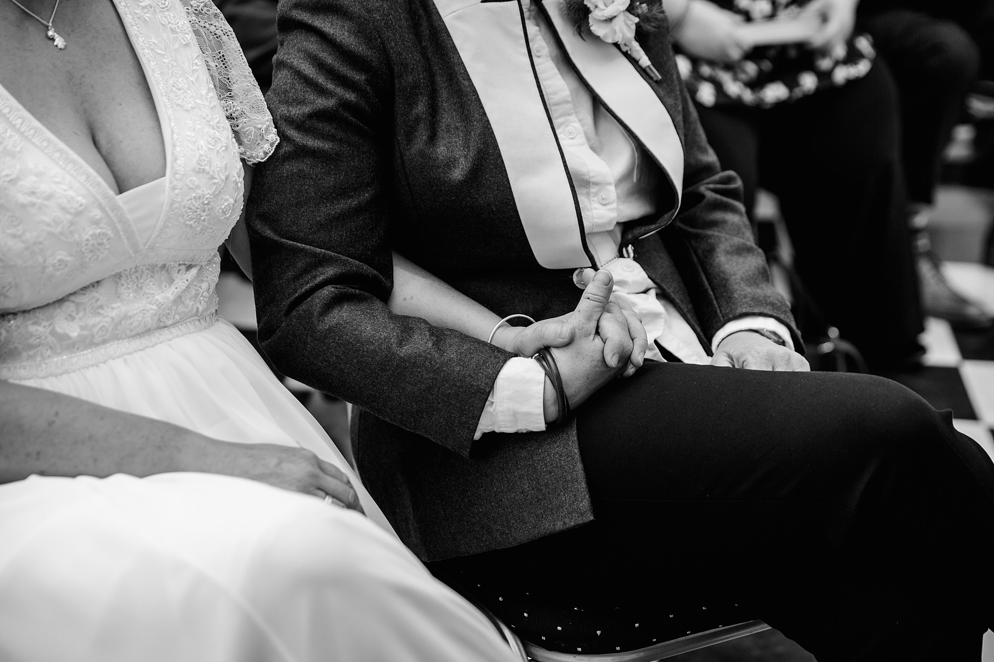 close up of brides holding hands during york house ceremony