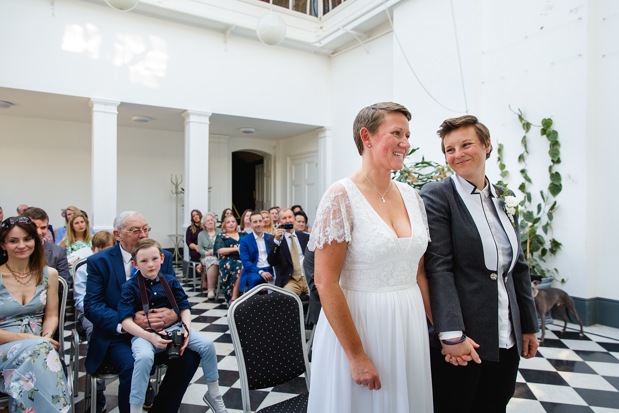 brides stand together for wedding ceremony at york house