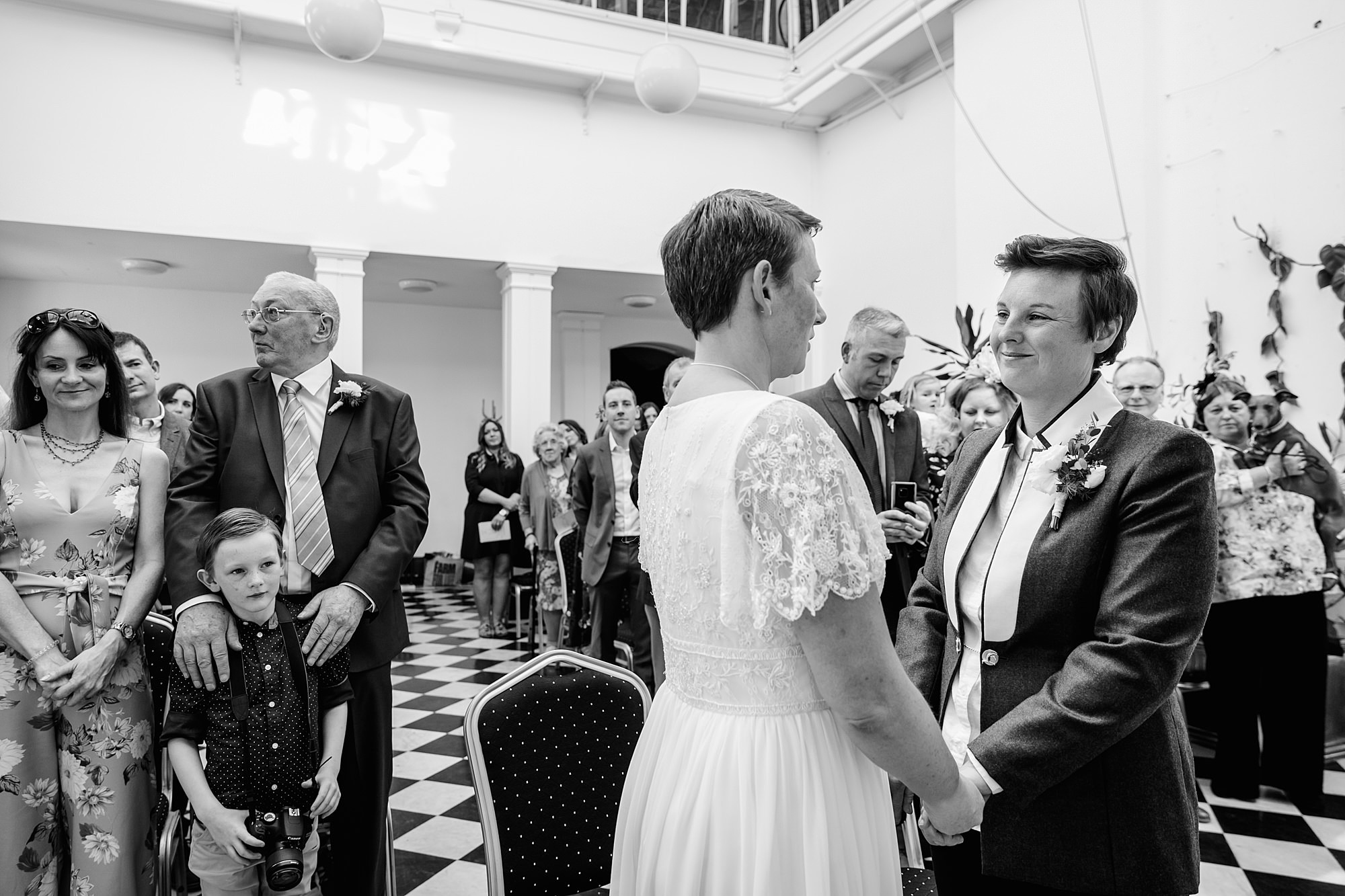 Twickenham wedding photography brides exchange vows at york house