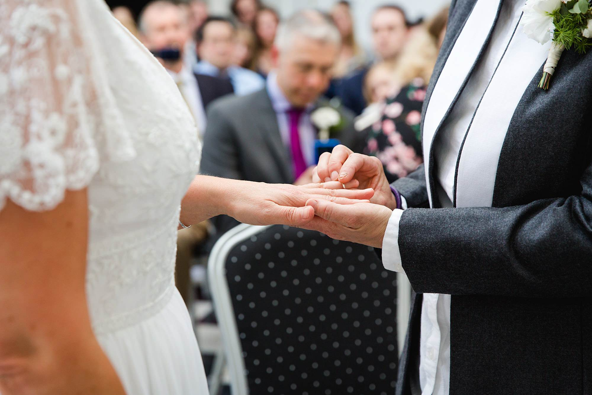 Twickenham wedding photography brides exchange rings at york house