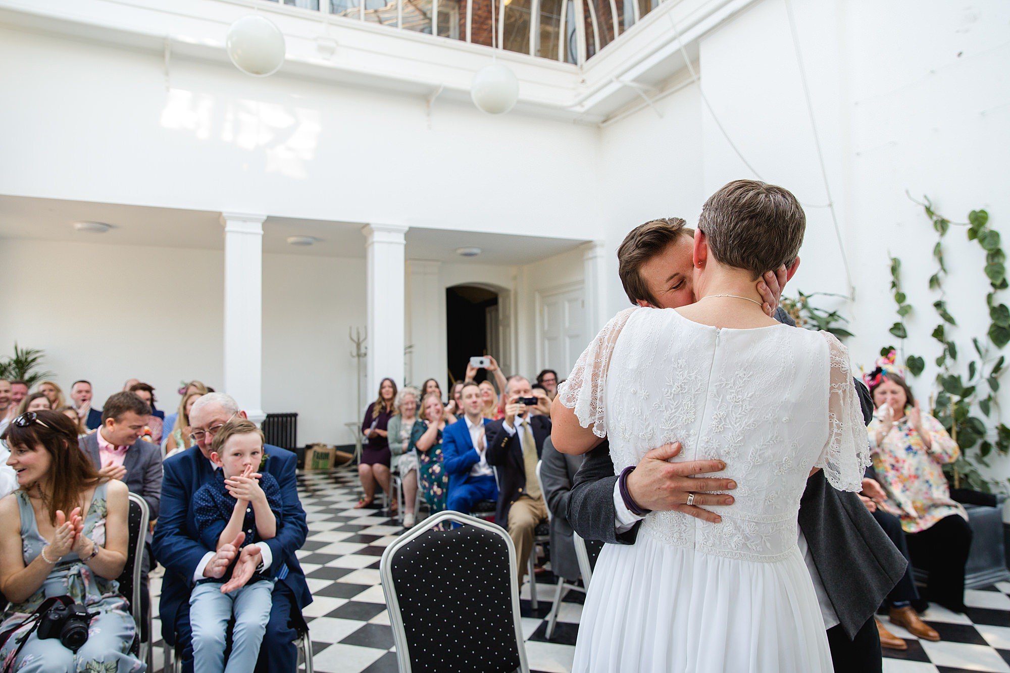 Twickenham wedding photography brides kiss after york house ceremony