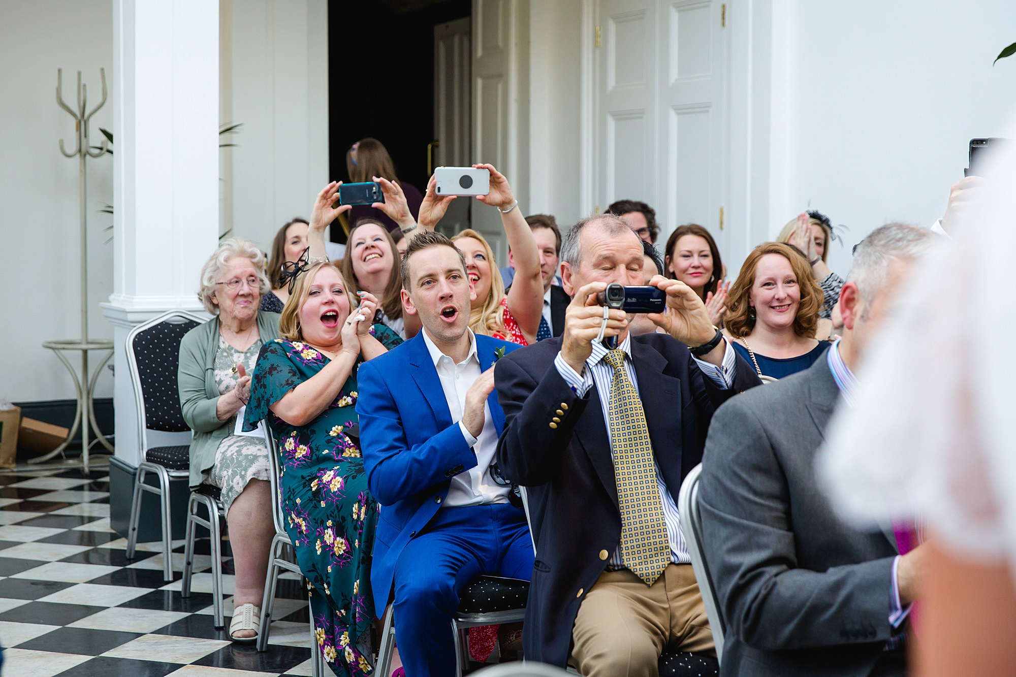 Twickenham wedding photography guests cheer for married couple at york house