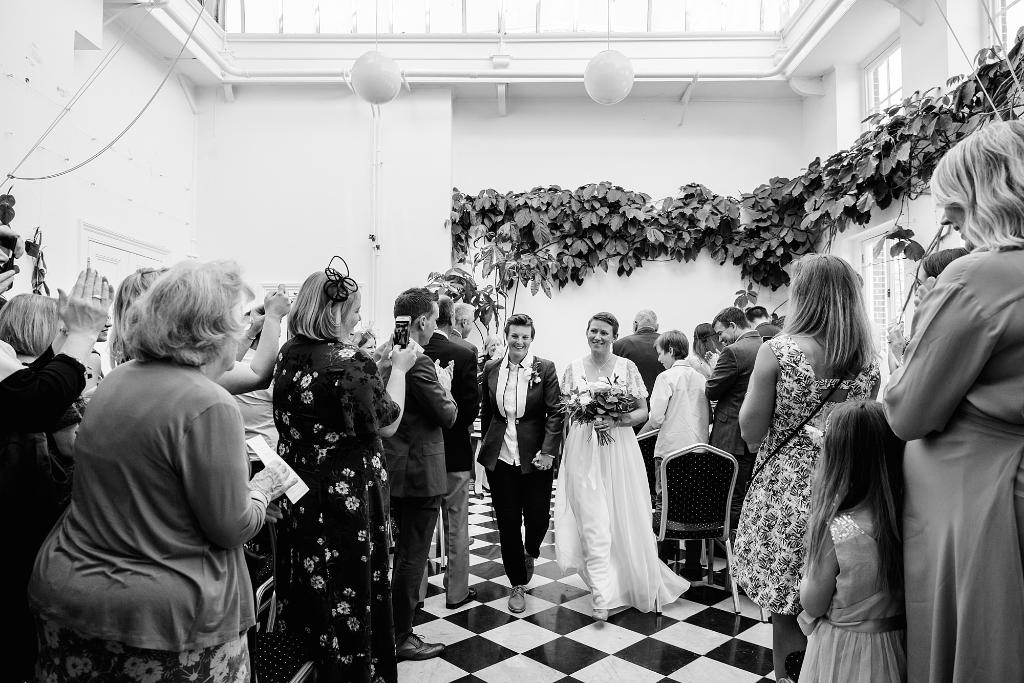 Twickenham wedding photography brides walk back down aisle after wedding ceremony