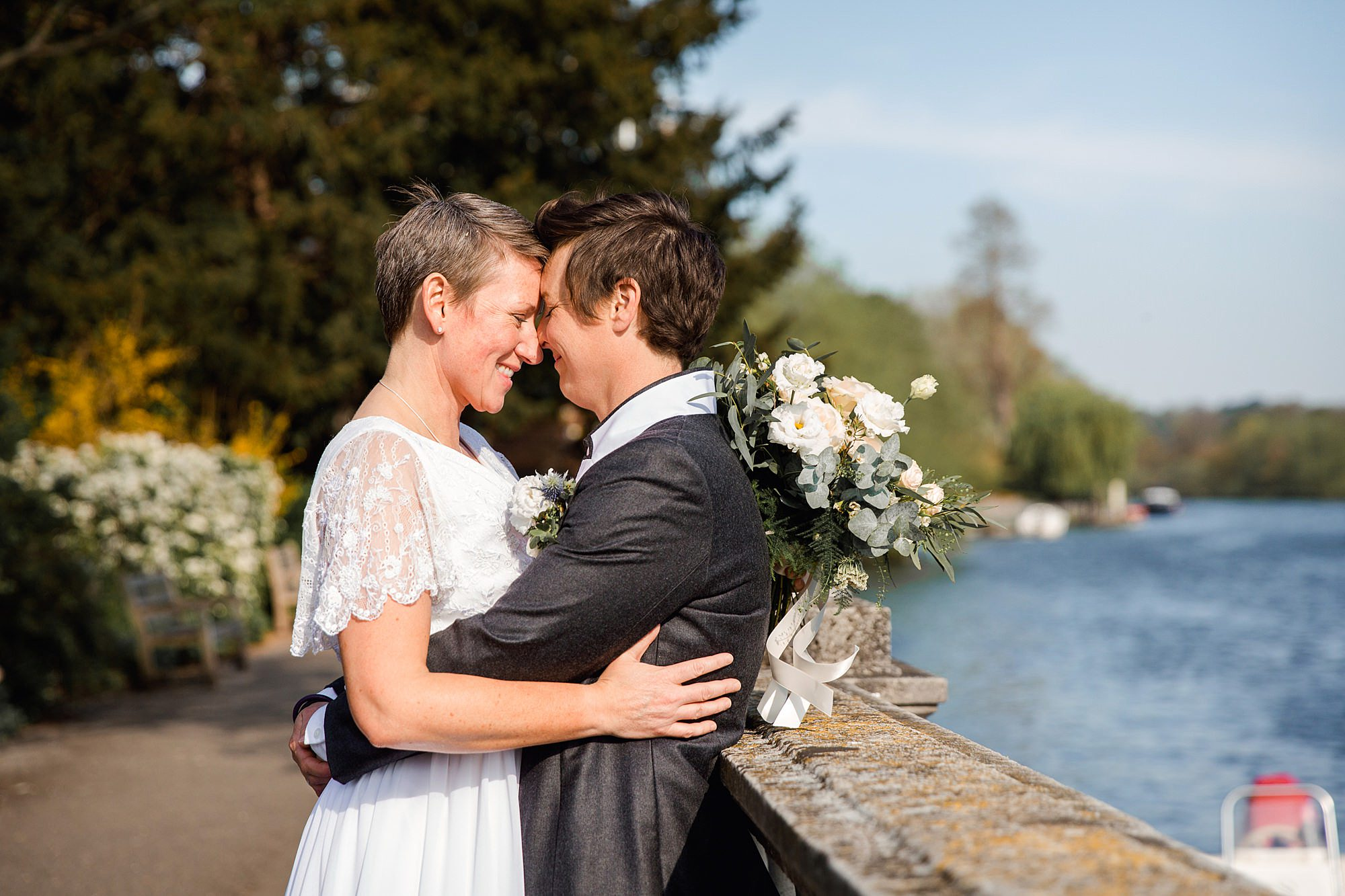 Twickenham wedding photography portrait of brides by river thames