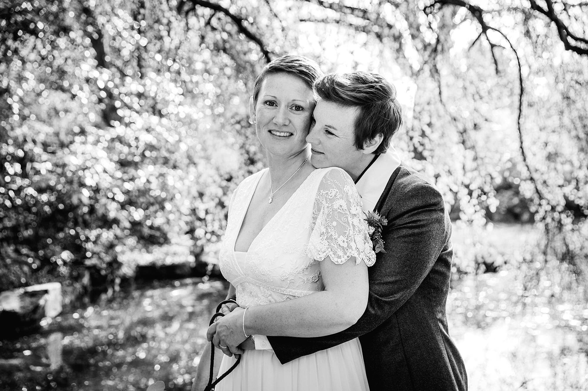 Twickenham wedding photography brides together under trees