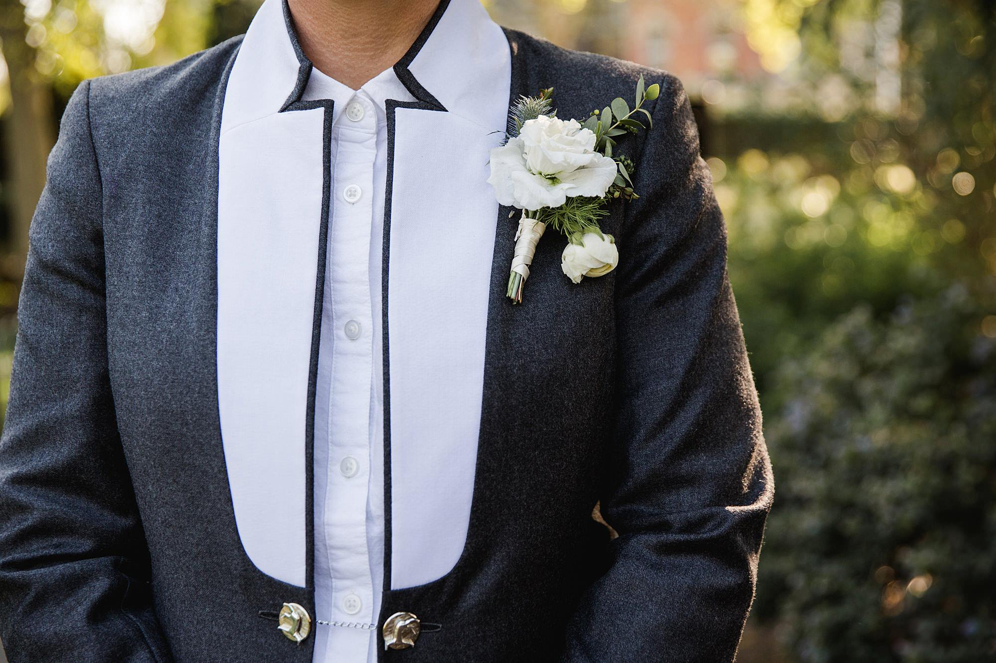 Twickenham wedding photography bride shows off her custom made wedding jacket