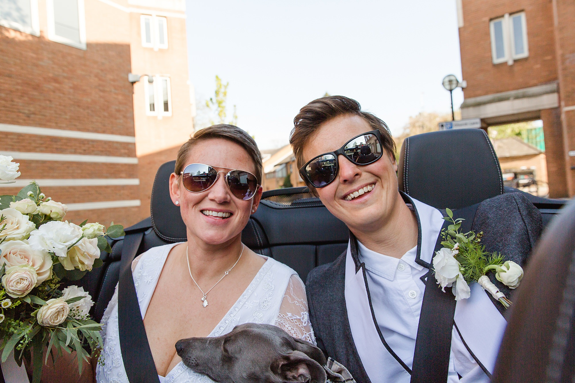 Twickenham wedding photography brides wearing sunglasses in their car on way to reception