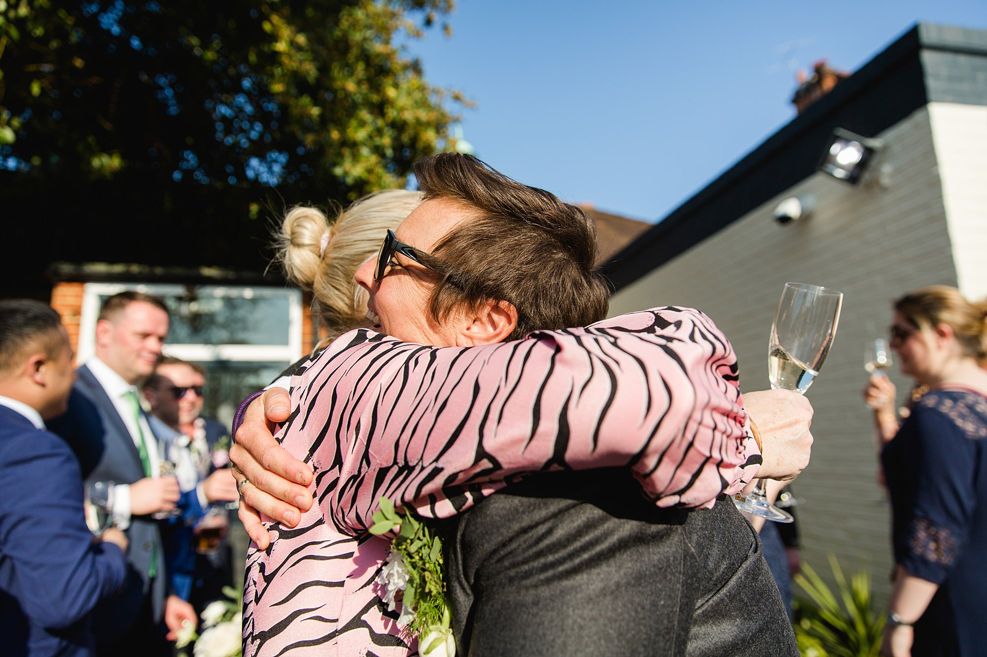 wedding guest hugs bride at turks head pub reception